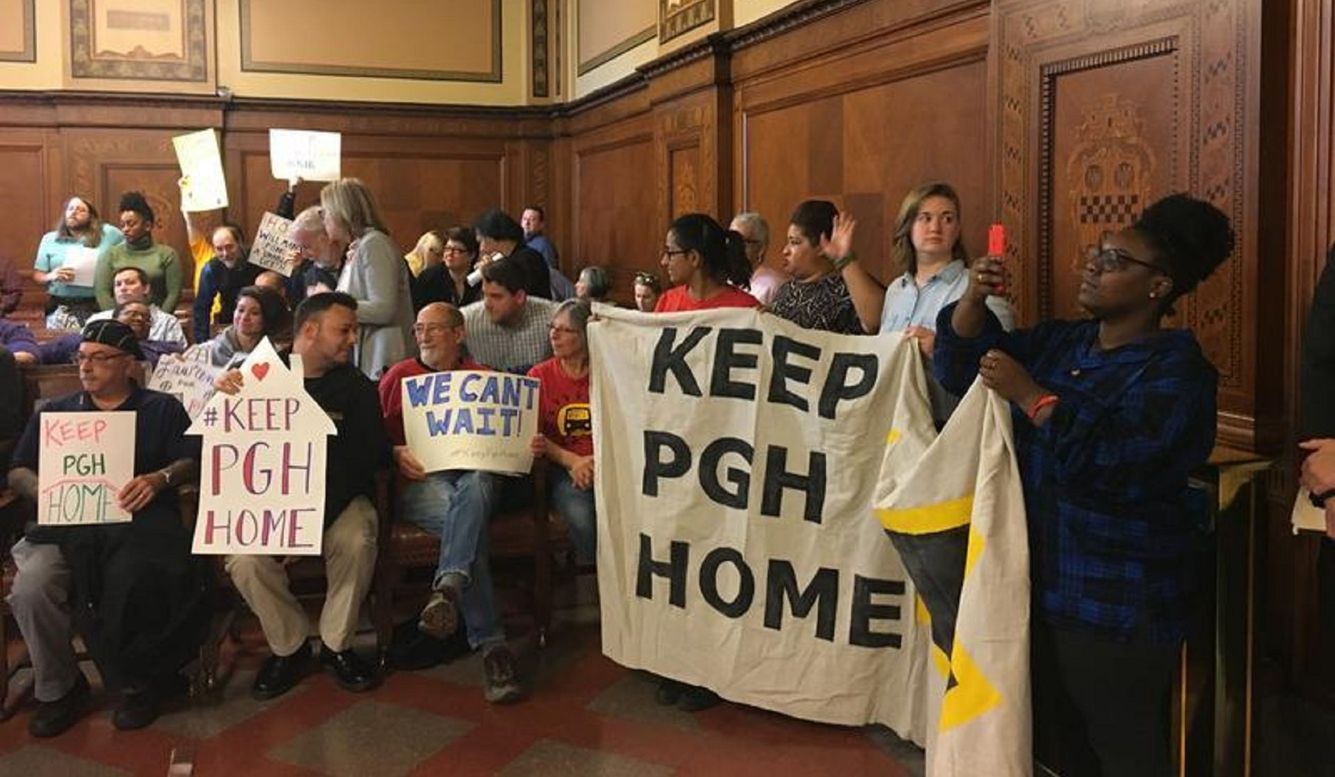 In this Dec. 2017 photo, activists urge Pittsburgh City Council to approve a funding source for the Housing Opportunity Fund.