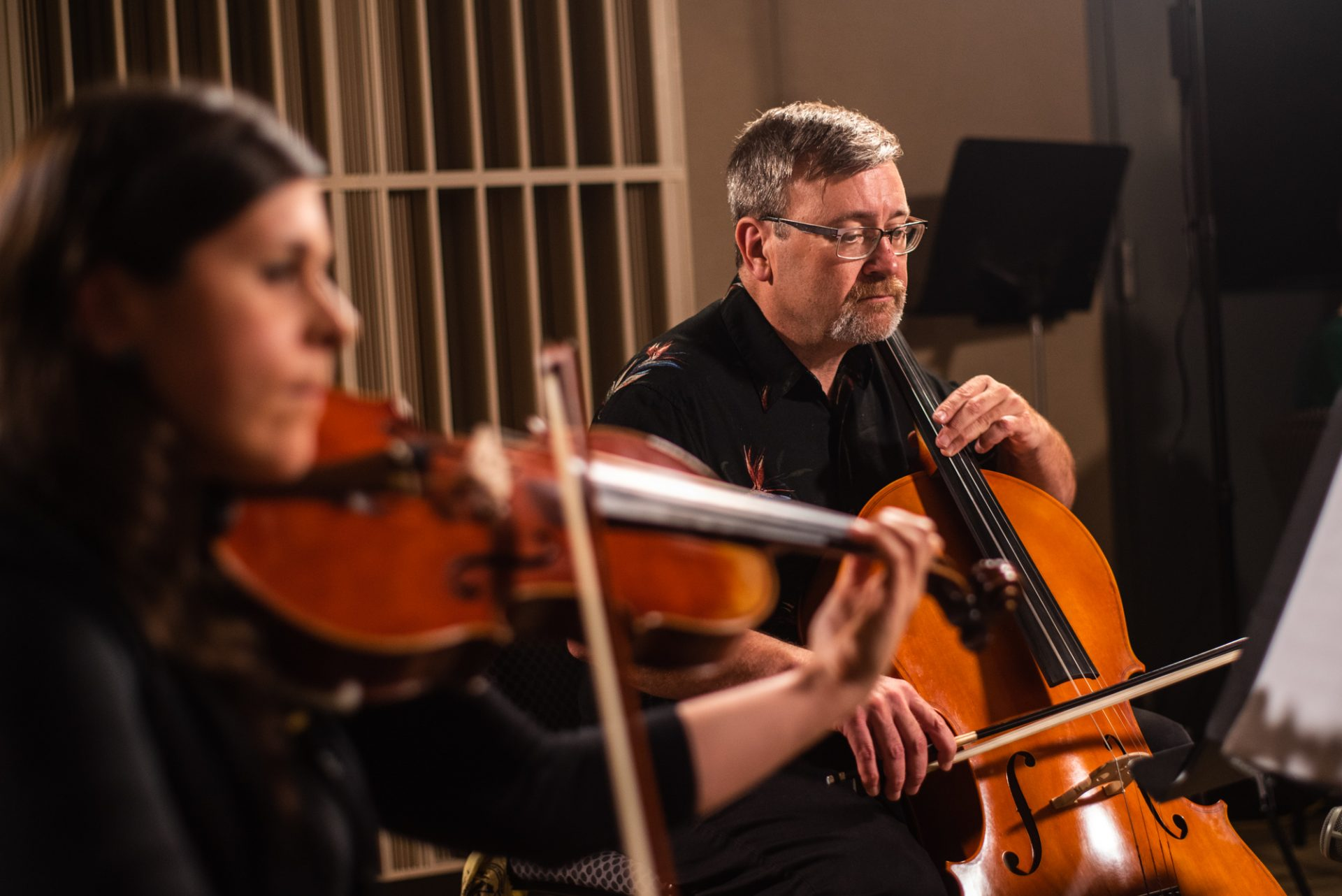 Cellist Matt Masek performing with Sempre Dolce