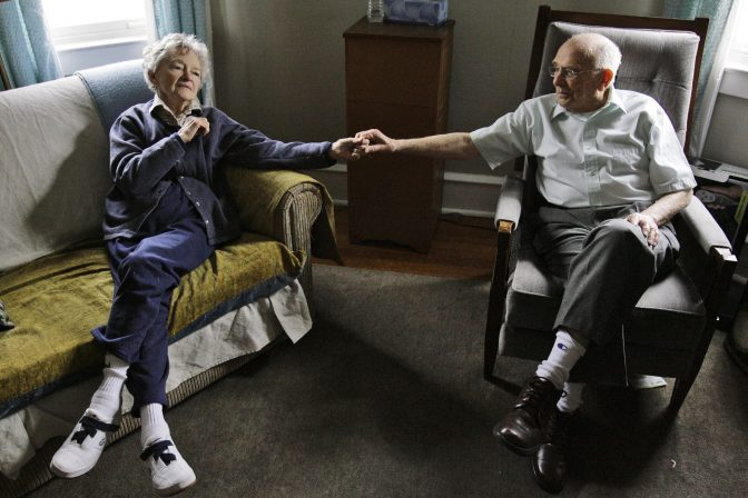 Alzheimer's patient Dorothy Eckert and her husband John Eckert's hold hands at their home in Norristown Pa., Thursday, April 19, 2007. Alzheimer's caregivers seldom can make time in their daily grind to seek out help. And when they do, they too often find waiting lists for services, or programs geared only toward people with advanced disease and not the larger pool in the purgatory that is dementia's decade-long middle ground between independence and helplessness.
