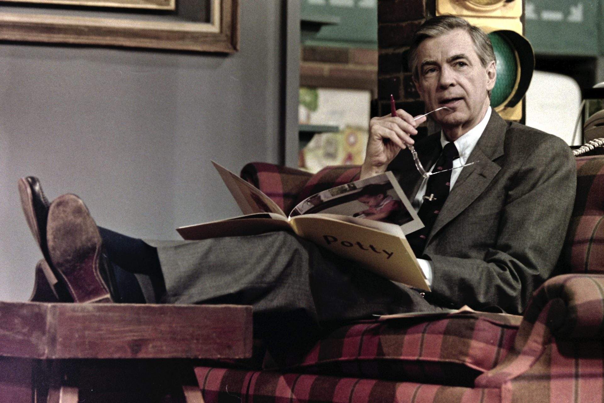 This June 28, 1989 file photo shows Fred Rogers making notes between takes on the set of his children's television program, Mister Rogers' Neighborhood, in Pittsburgh.