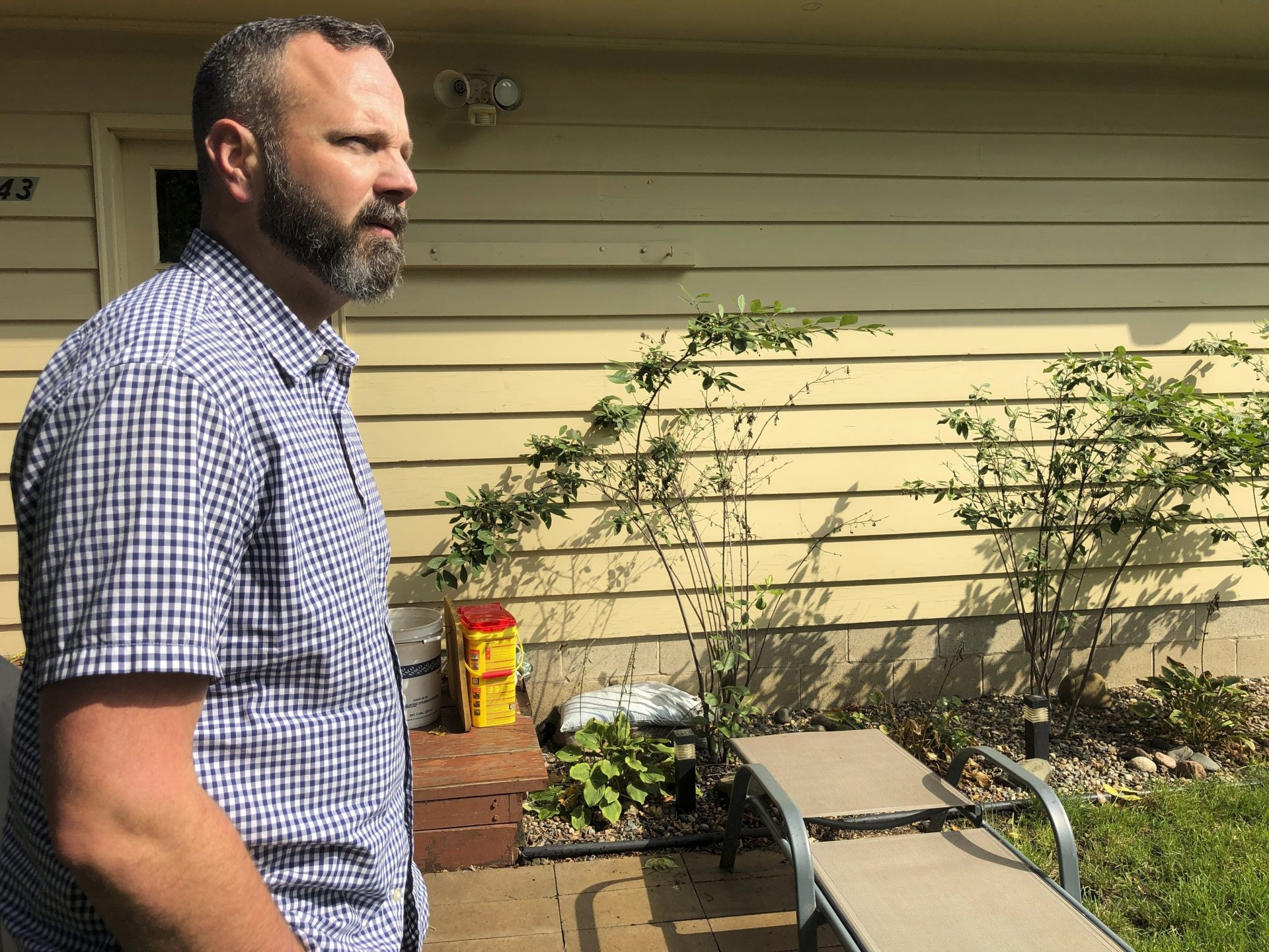 """Dr. Jim Richter, a survivor of sexual abuse by a priest who is a member of the review board in the Archdiocese of St. Paul and Minneapolis, walks outside his home in Minneapolis, on Sept. 21, 2019. Richter praises the work of the review board he serves on, but says others are full of """"unqualified, well-meaning, but ultimately incompetent"""" members."""