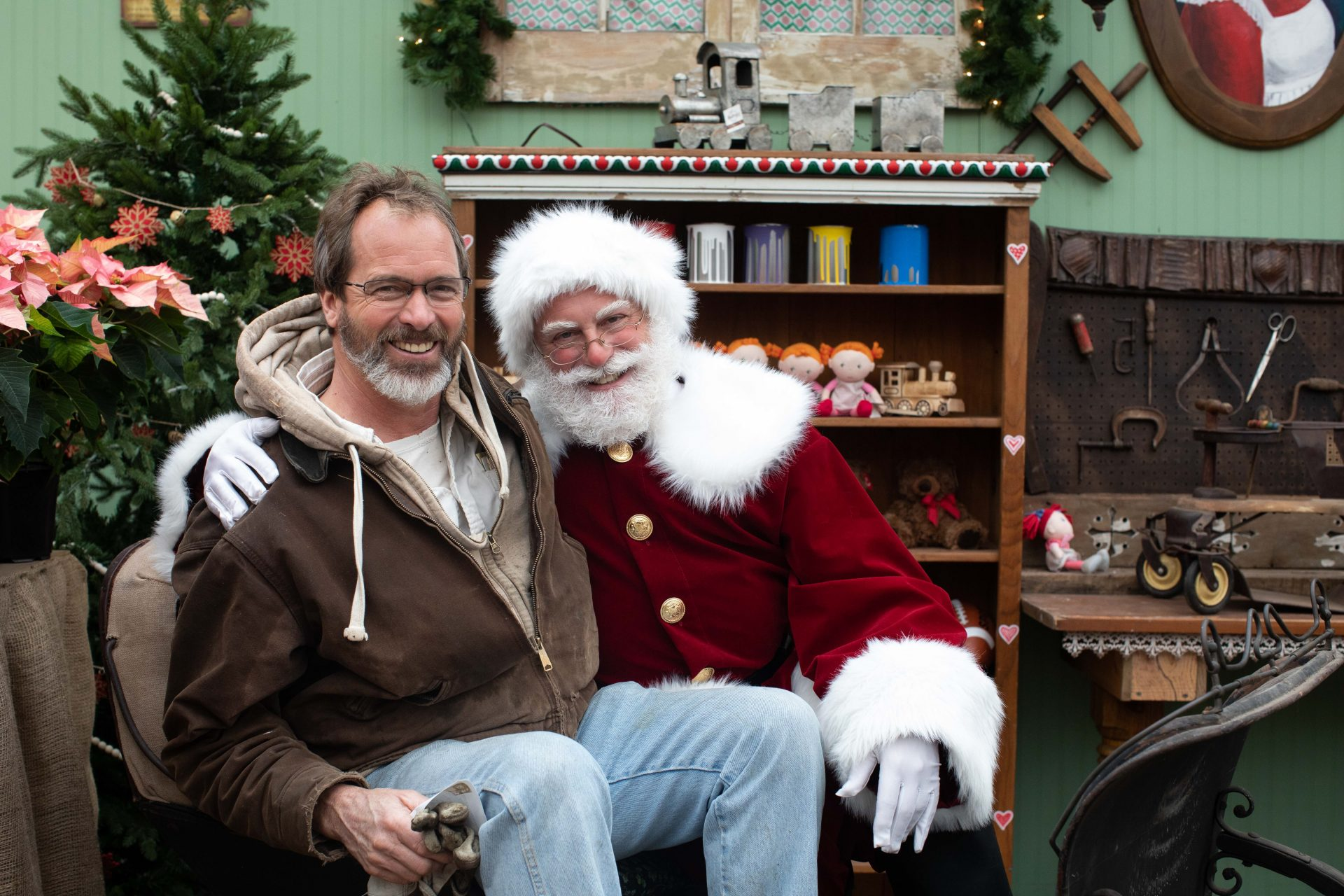Norm Schultz, Farm Manager of Linvilla Orchards in Media, Pennsylvania poses with Santa Claus, played by Steve Nieman of Springfield, PA. Linvilla Orchards has thrived by diversifying their operations and offering a complete Christmas experience to visitors.