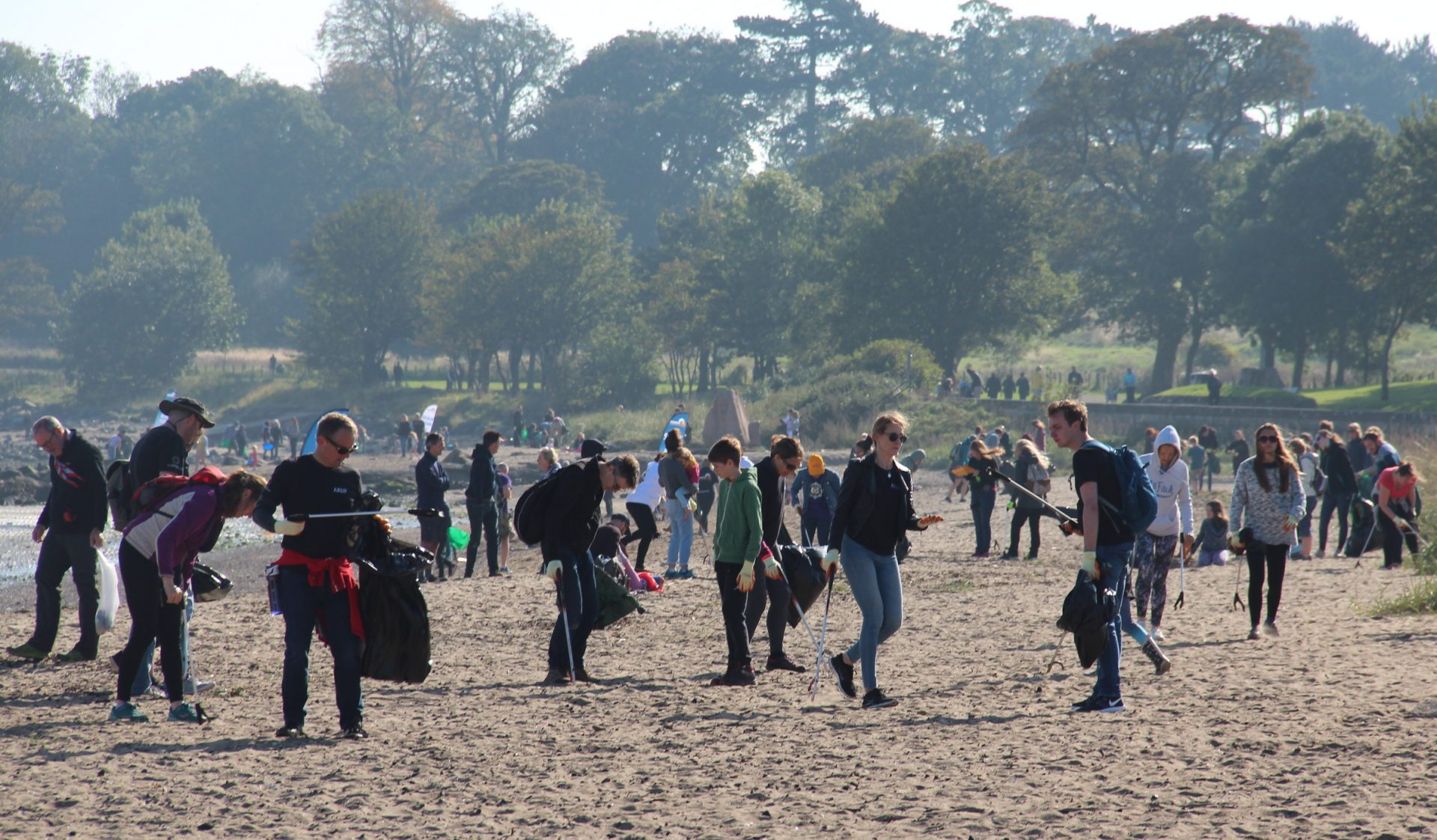 Volunteers cleaning plastic off Cramond Beach in Edinburgh.