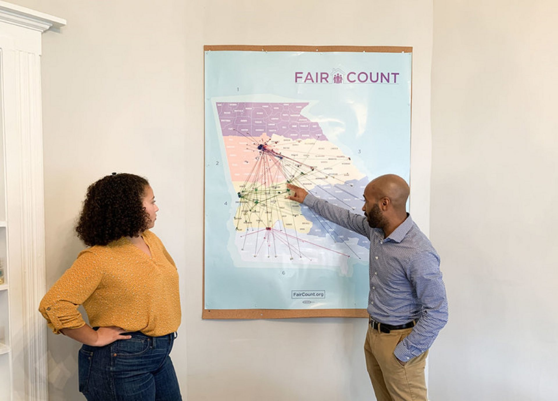 Ed Reed (right), Fair Count's program manager, and Djemanesh Aneteneh, an operations and events administrator, look over a map showing the Wi-Fi hotspots the group has installed around Georgia.