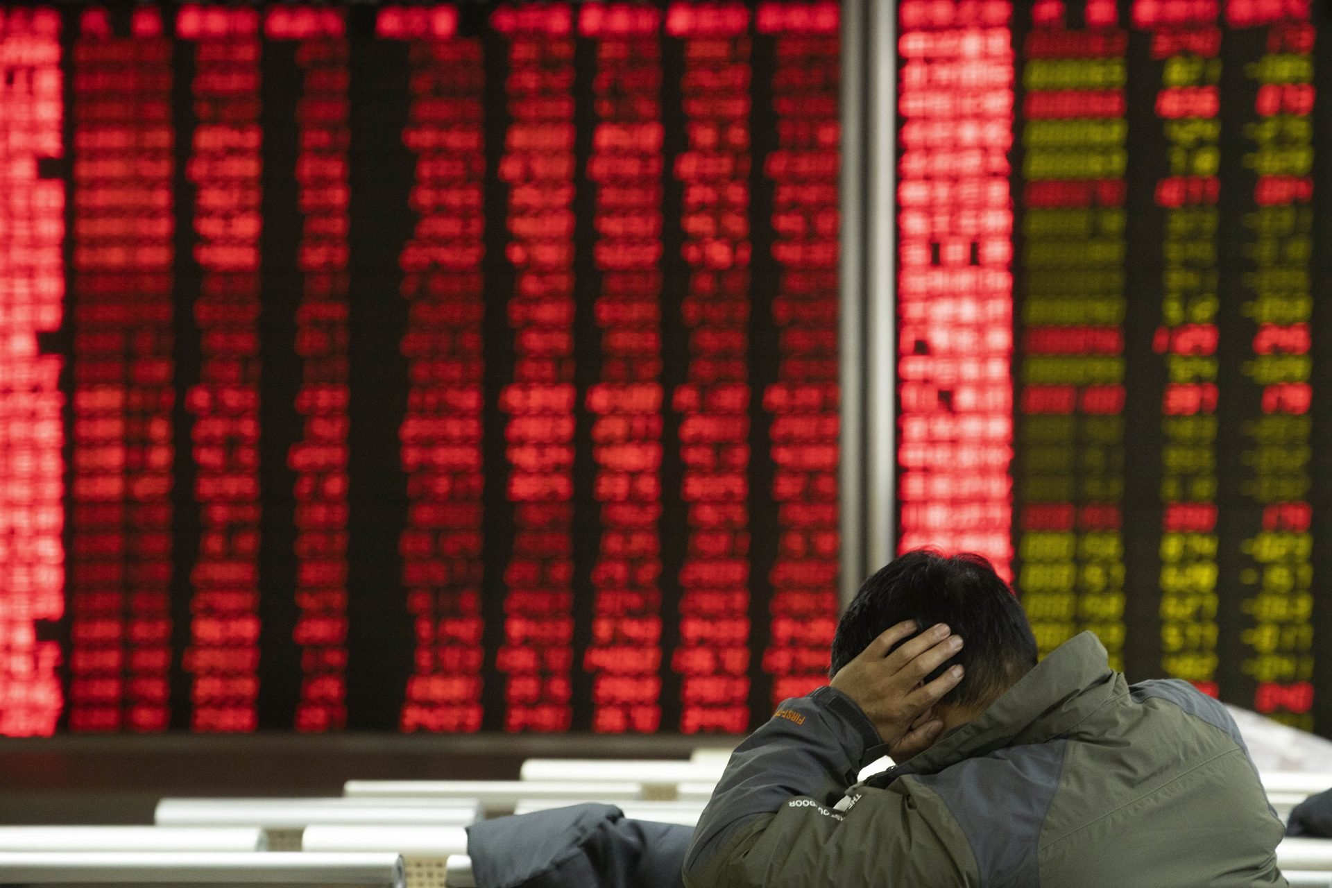 In this Thursday, Dec. 12, 2019, photo, an investor monitors stock prices at a brokerage in Beijing. Shares likewise jumped Friday, Dec. 13, 2019 in Asia following fresh all-time highs overnight on Wall Street spurred by optimism that the U.S. and China are close to reaching a deal to end their costly trade war.