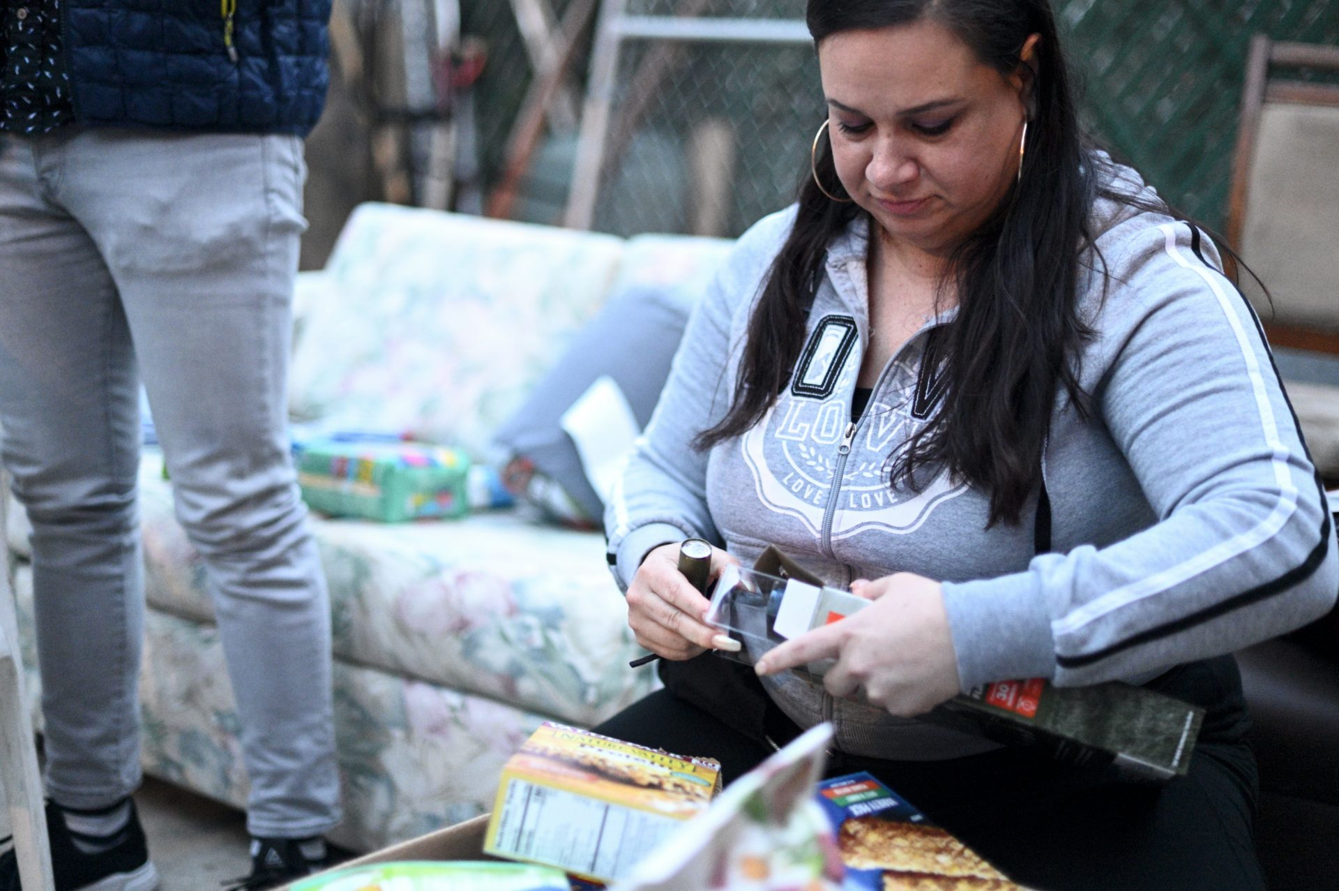 Activist and community organizer Venessa Maria Graber packs emergency items to be donated as a disaster relief package, during a meeting of Philly Boricuas, on Saturday, in North Philadelphia.