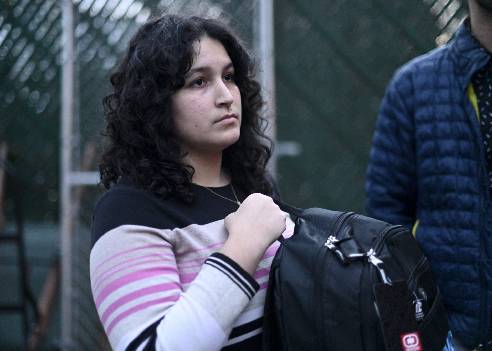 Activist and community organizer Puchi De Jesus holds up a backpack with emergency items to be donated as a disaster relief package, during a meeting of Philly Boricuas, on Saturday, in North Philadelphia.