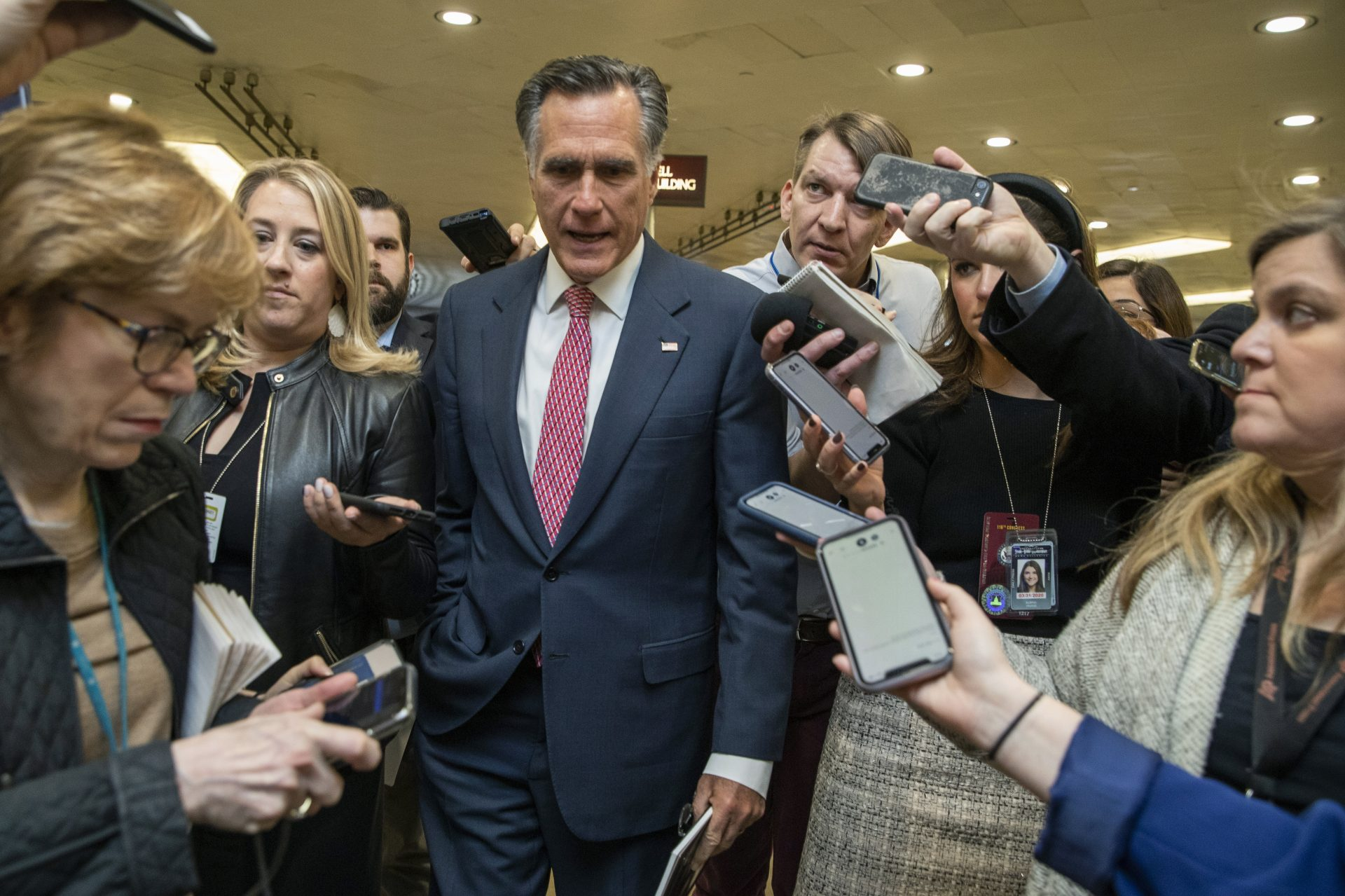 Sen. Mitt Romney, R-Utah, speaks to reporters as he arrives at the Capitol in Washington, Monday, Jan. 27, 2020, during the impeachment trial of President Donald Trump on charges of abuse of power and obstruction of Congress.