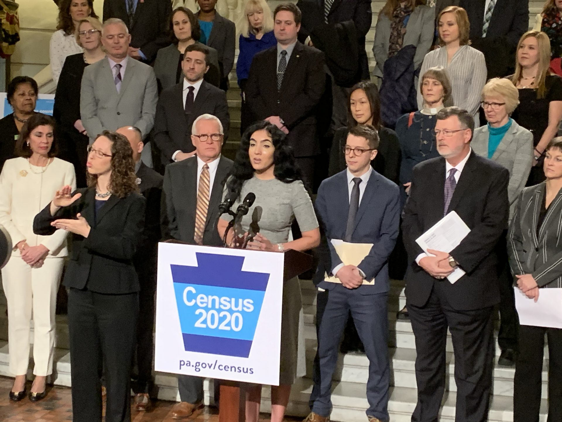 Pennsylvania's second lady Gisele Fetterman (at podium) announces at a Capitol news conference her upcoming statewide tour to try to get hard-to-reach populations to participate in the 2020 U.S. census.