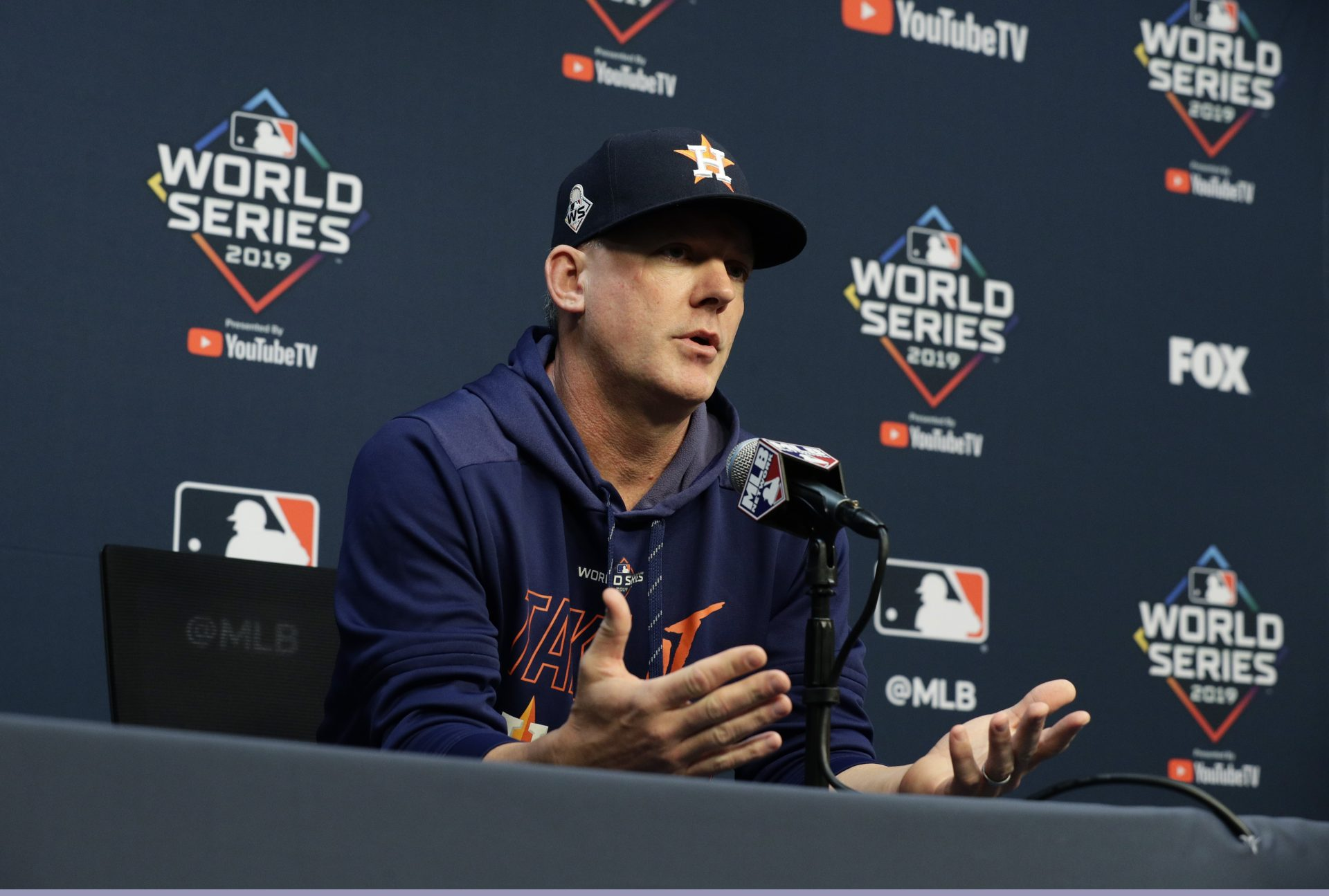FILE - In this Oct. 28, 2019, file photo, Houston Astros manager AJ Hinch talks to the media during a news conference for baseball's World Series, in Houston. Houston manager AJ Hinch and general manager Jeff Luhnow were suspended for the entire season Monday, Jan. 13, 2020, and the team was fined $5 million for sign-stealing by the team in 2017 and 2018 season. Commissioner Rob Manfred announced the discipline and strongly hinted that current Boston manager Alex Cora — the Astros bench coach in 2017 — will face punishment later. Manfred said Cora developed the sign-stealing system used by the Astros.