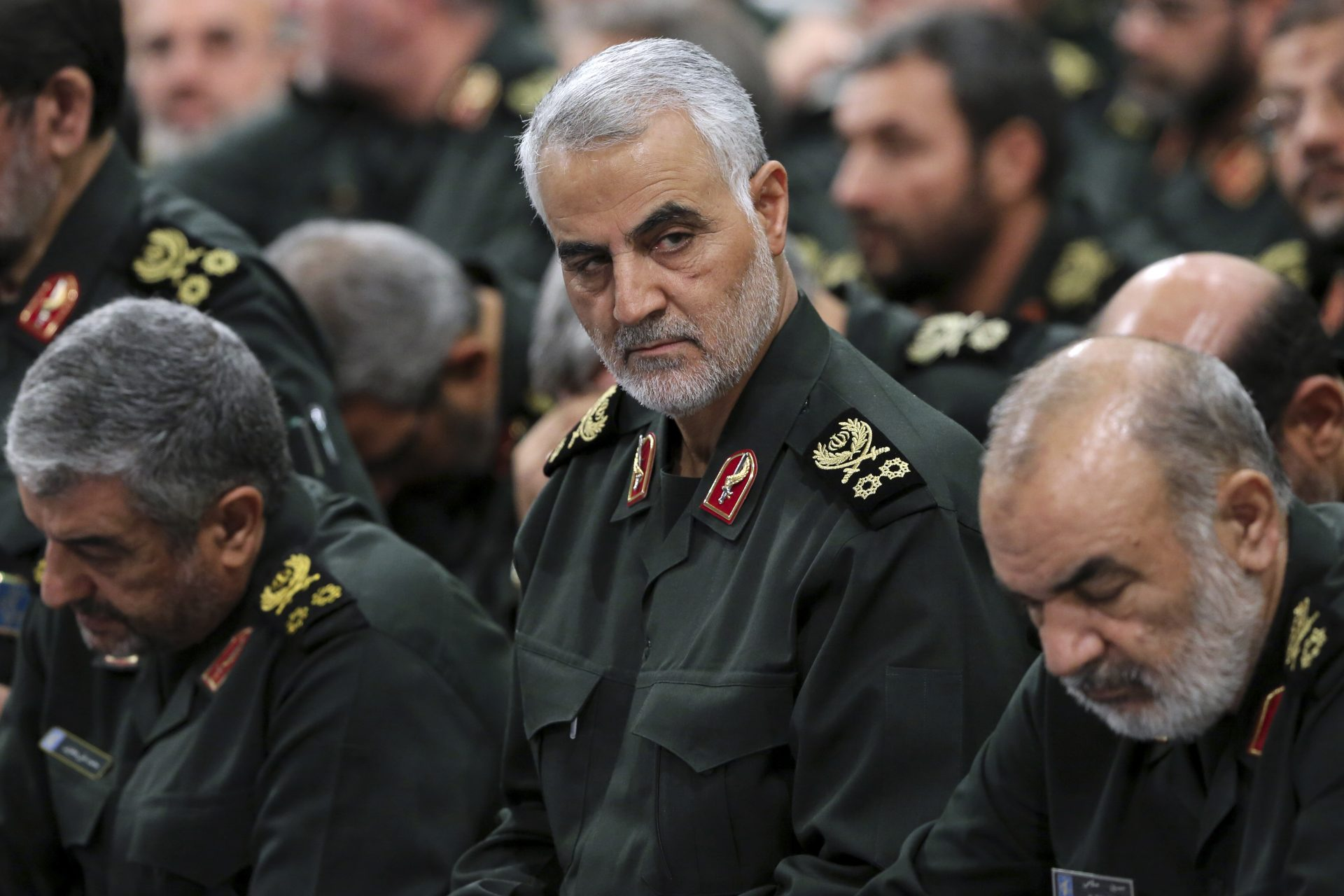 FILE PHOTO: In this Sept. 18, 2016 file photo released by an official website of the office of the Iranian supreme leader, Revolutionary Guard Gen. Qassem Soleimani, center, attends a meeting in Tehran, Iran. The long shadow war between Israel and Iran has burst into the open in recent days, with Israel allegedly striking Iran-linked targets as far away as Iraq and crash-landing two drones in Lebanon. These incidents, along with an air raid in Syria that Israel says thwarted an imminent Iranian drone attack, have raised tensions at a particularly fraught time. Israel said Soleimani masterminded the alleged drone attack.