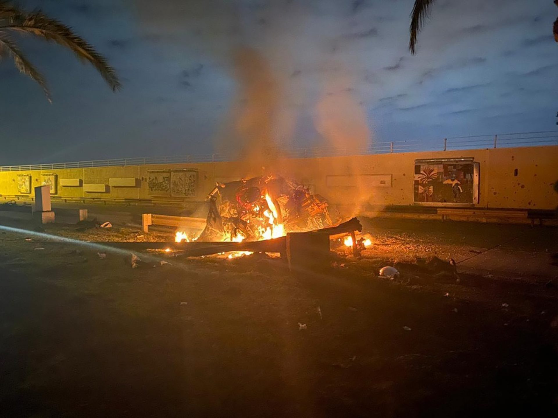 This photo released by the Iraqi Prime Minister Press Office shows a burning vehicle at the Baghdad International Airport following an airstrike in Baghdad, Iraq, early Friday, Jan. 3, 2020. The Pentagon said Thursday that the U.S. military has killed Gen. Qassem Soleimani, the head of Iran's elite Quds Force, at the direction of President Donald Trump.