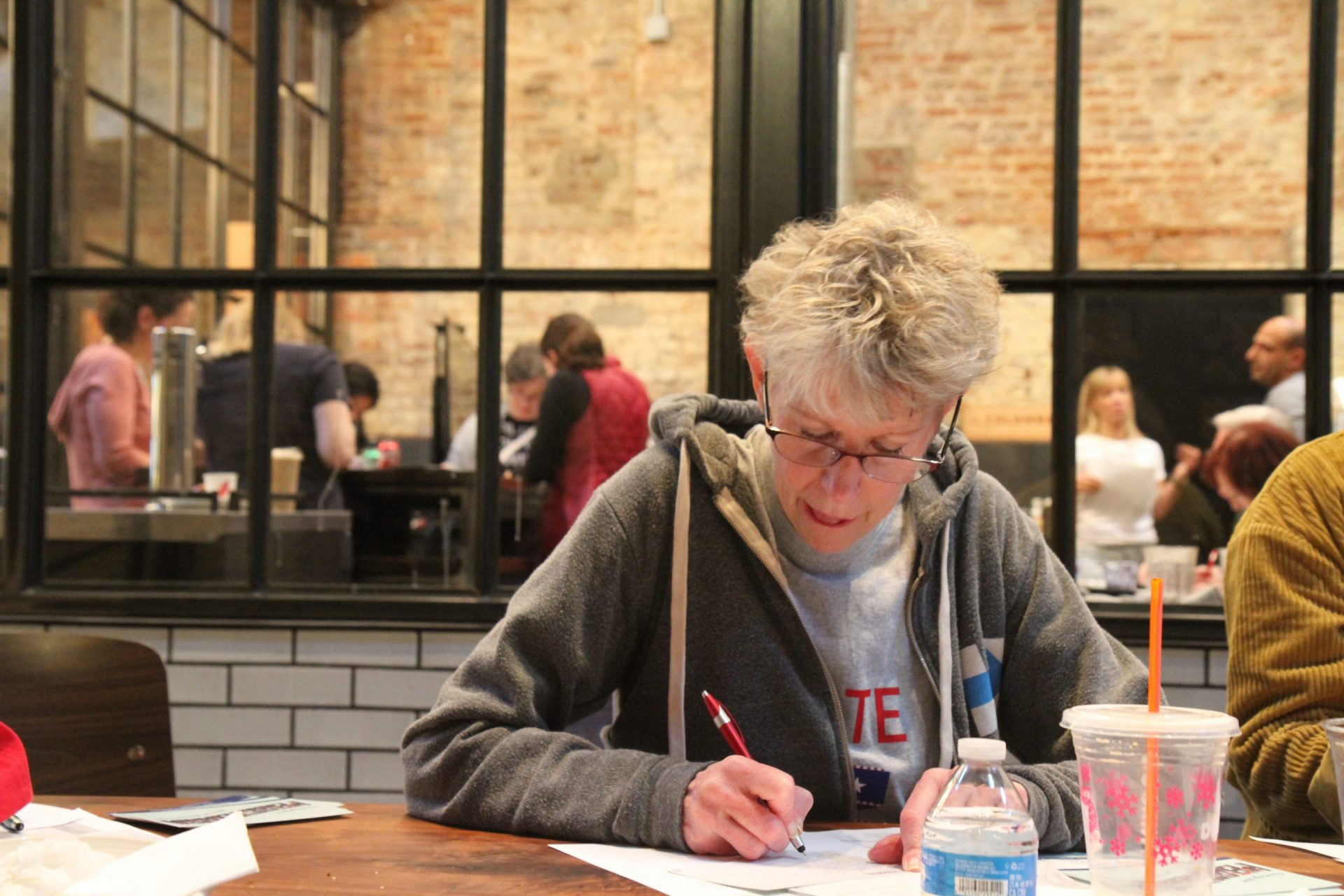 Elaine Griffin makes her pitch for Sen. Elizabeth Warren to Iowa caucus-goers via postcard