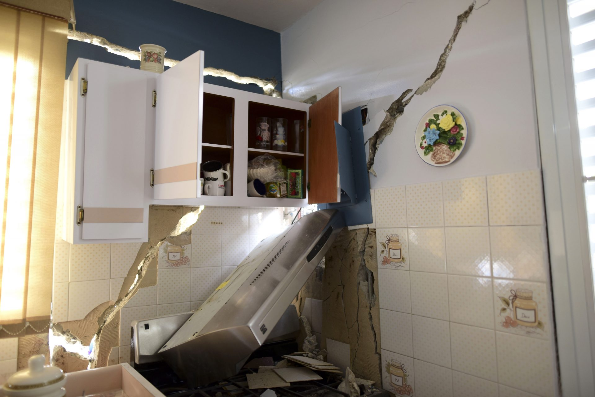 The house of William Mercuchi is damaged after the previous day's magnitude 6.4 earthquake in Yauco, Puerto Rico, Wednesday, Jan. 8, 2020. More than 250,000 Puerto Ricans remained without water on Wednesday and another half a million without power, which also affected telecommunications.
