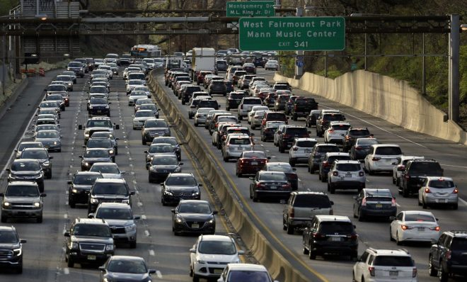 Rush-hour traffic heads west, right, and east, left, along the Schuylkill Expressway Wednesday, April 10, 2019 in Philadelphia.
