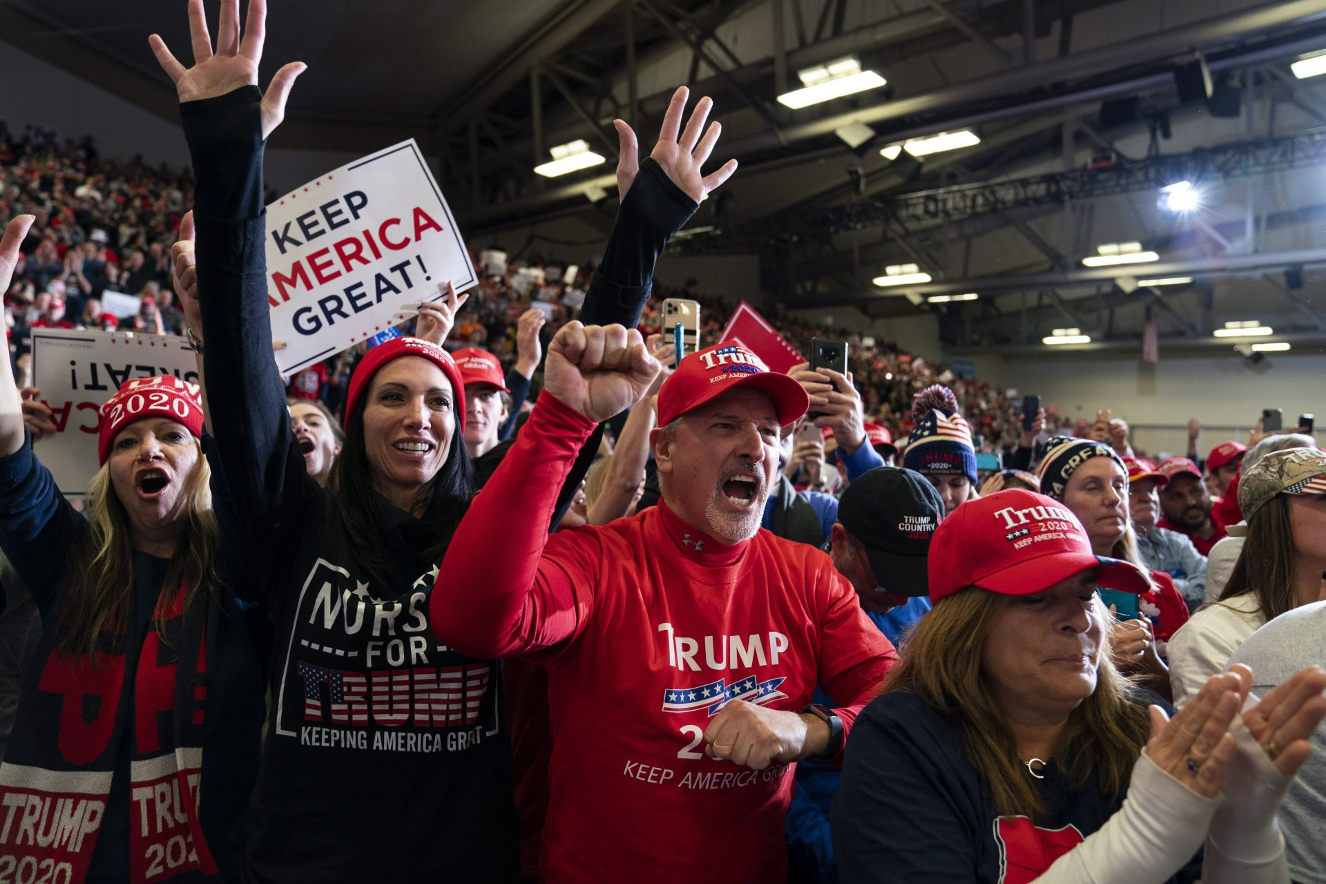 Supporters of President Donald Trump cheer as he speaks at a campaign rally at the Wildwoods Convention Center Oceanfront, Tuesday, Jan. 28, 2020, in Wildwood, N.J.