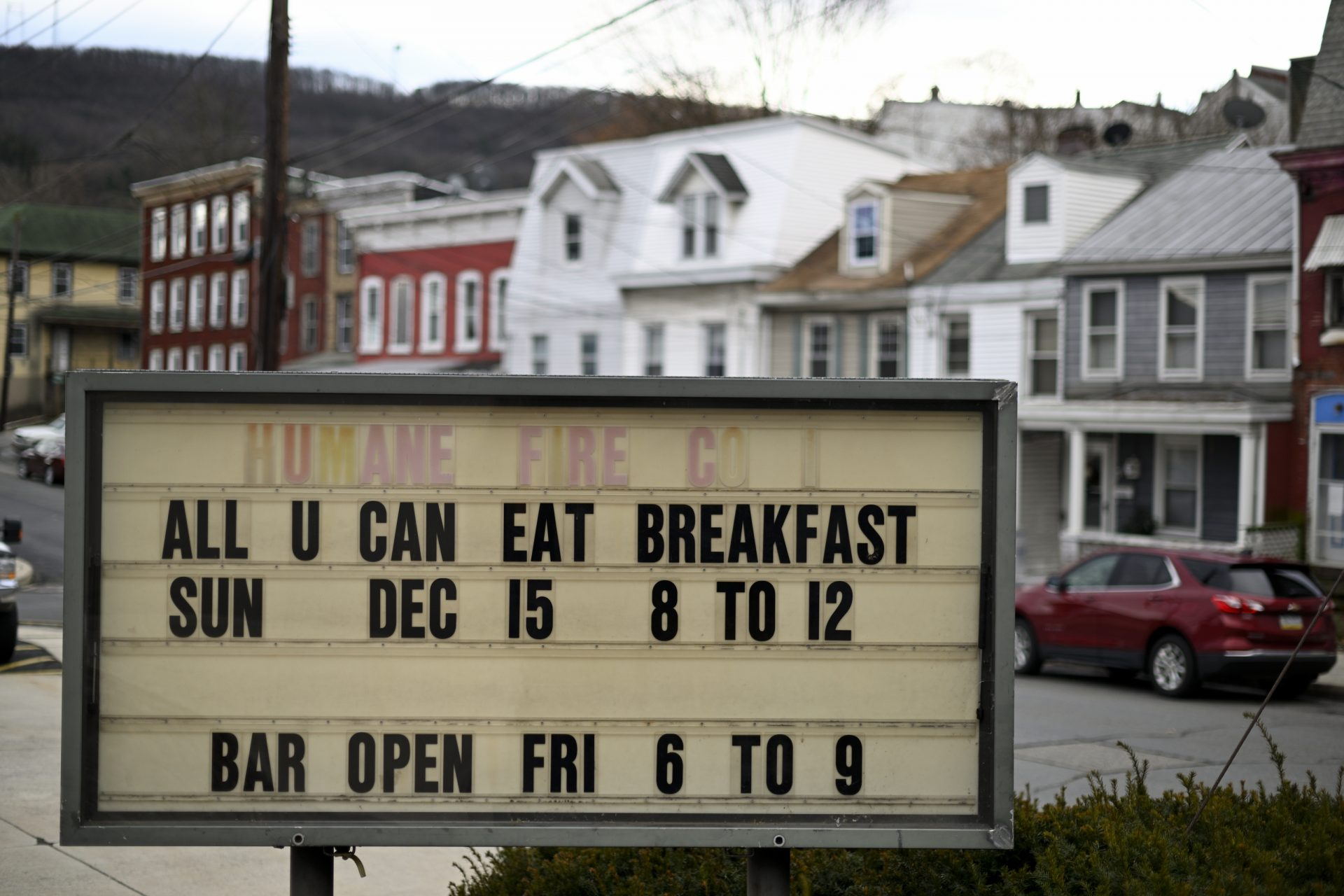 Upcoming social events held at the companies social hall are announced on the board outside Humane Fire Co., in Pottsville, PA, on December 15, 2019.