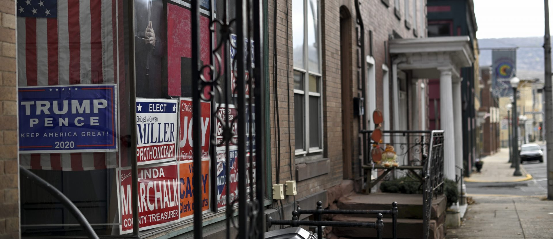 Campaign signs in support of Republican candidates and a cardboard cut-out portrait of President Donald Trump decorate a window along Hotel St. in Pottsville, PA, on December 15, 2019.