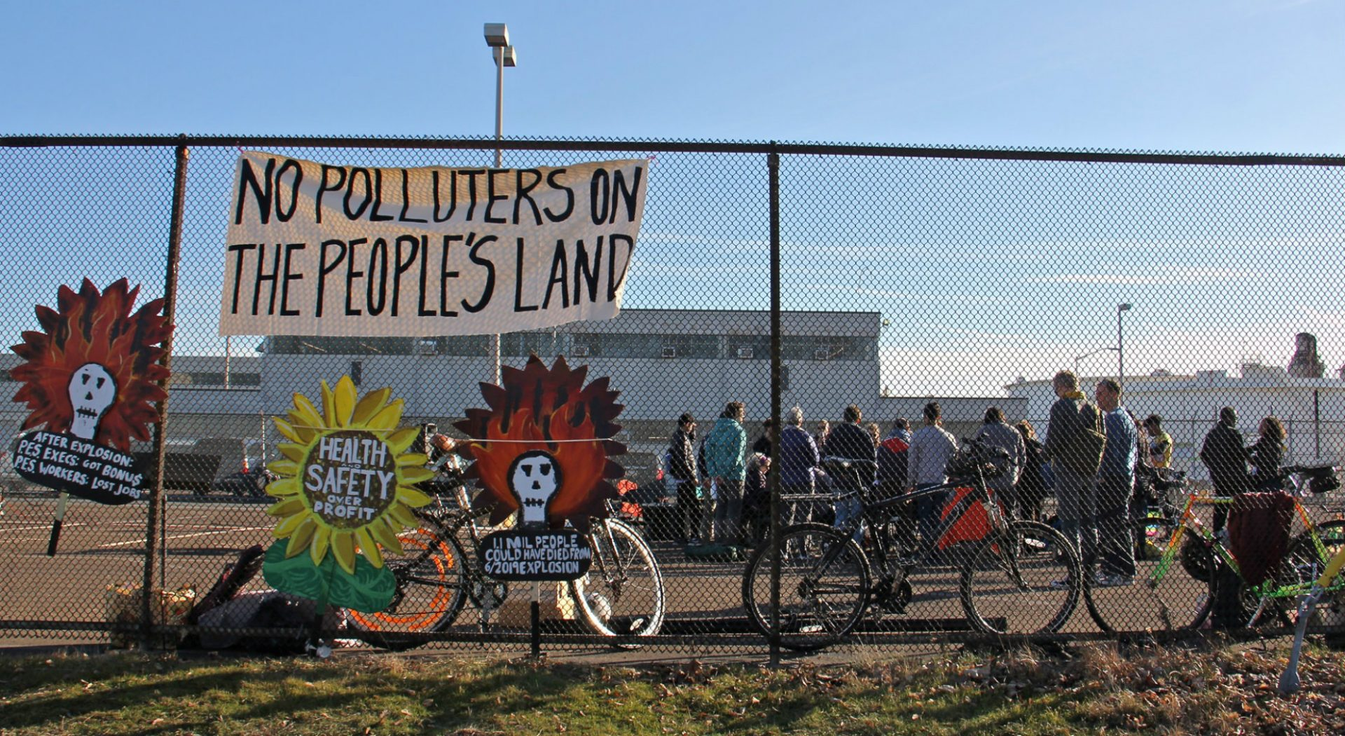 Protesters gather in a parking lot at the Philadelphia Energy Solutions refinery office on Passyunk Avenue in South Philadelphia. (Emma Lee/WHYY)