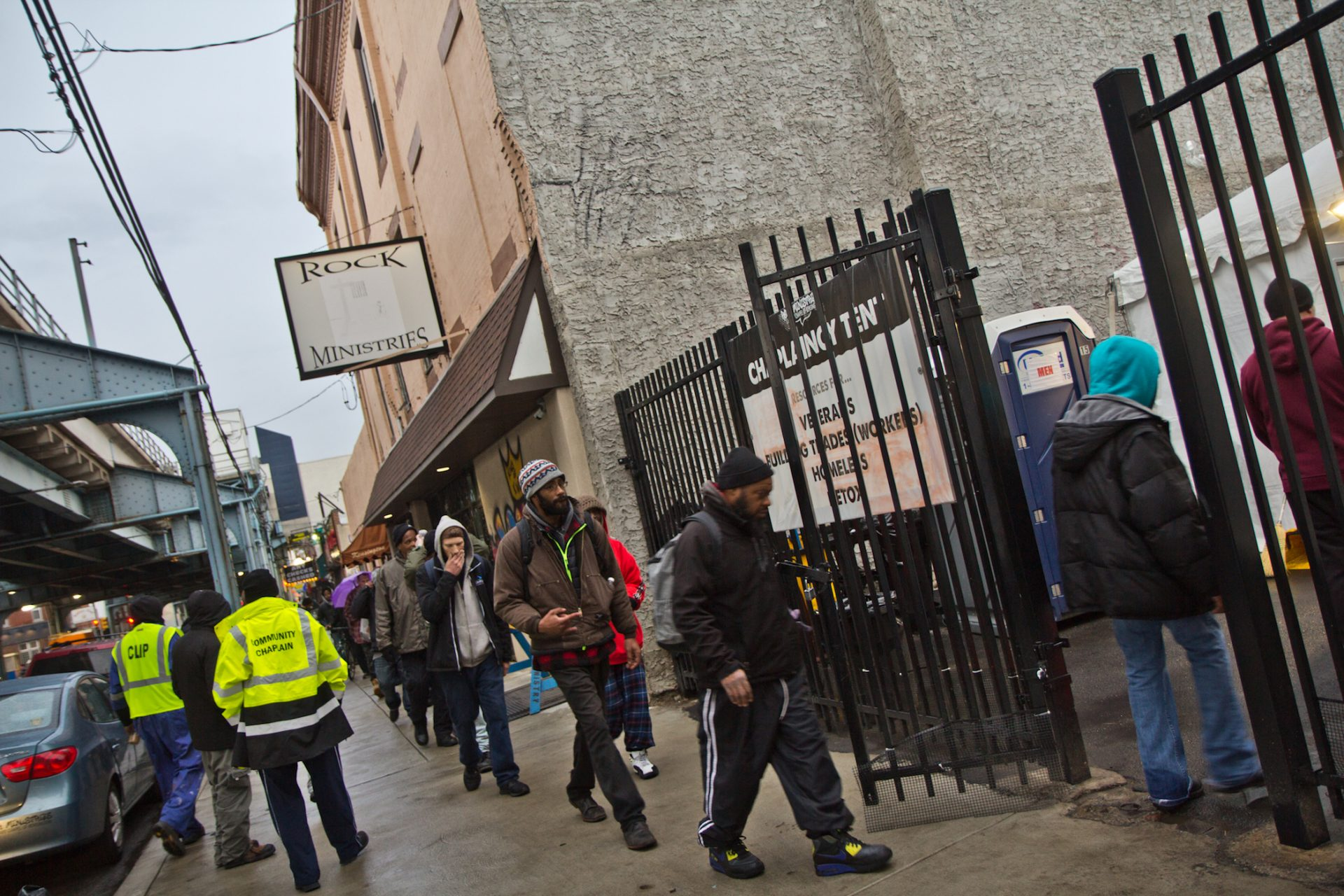 About 30 people wait in line for the chance for a day of work through the city of Philadelphia's Work-to-Earn program.