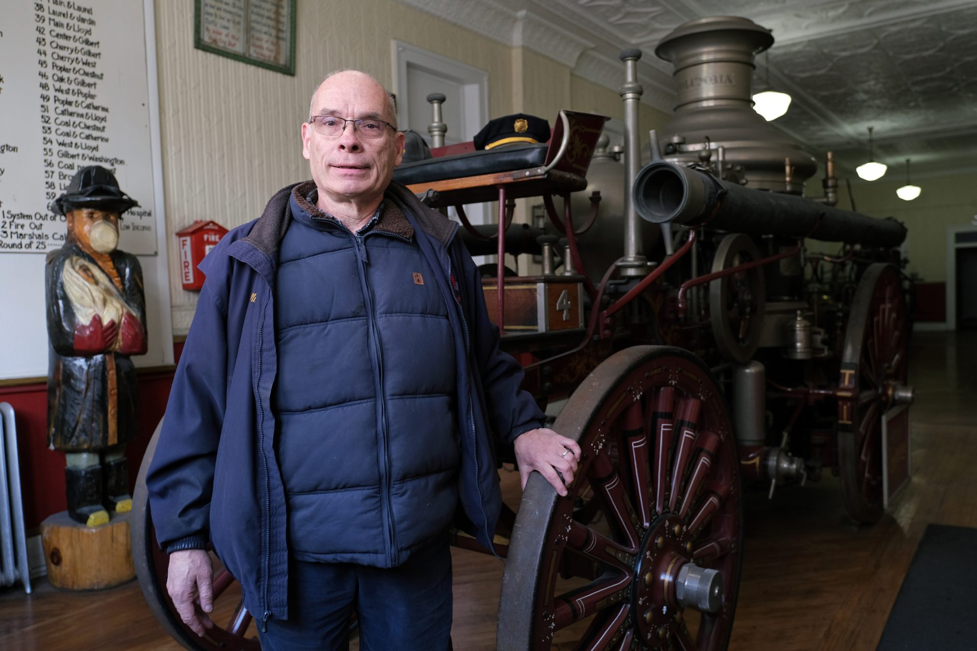 Veteran firefighter Mike Kitsock stands by a 1909 Ahrens Continental steam fire engine is displayed Jan. 16, 2020, at the Schuylkill Historical Fire Society in Shenandoah, Pennsylvania.