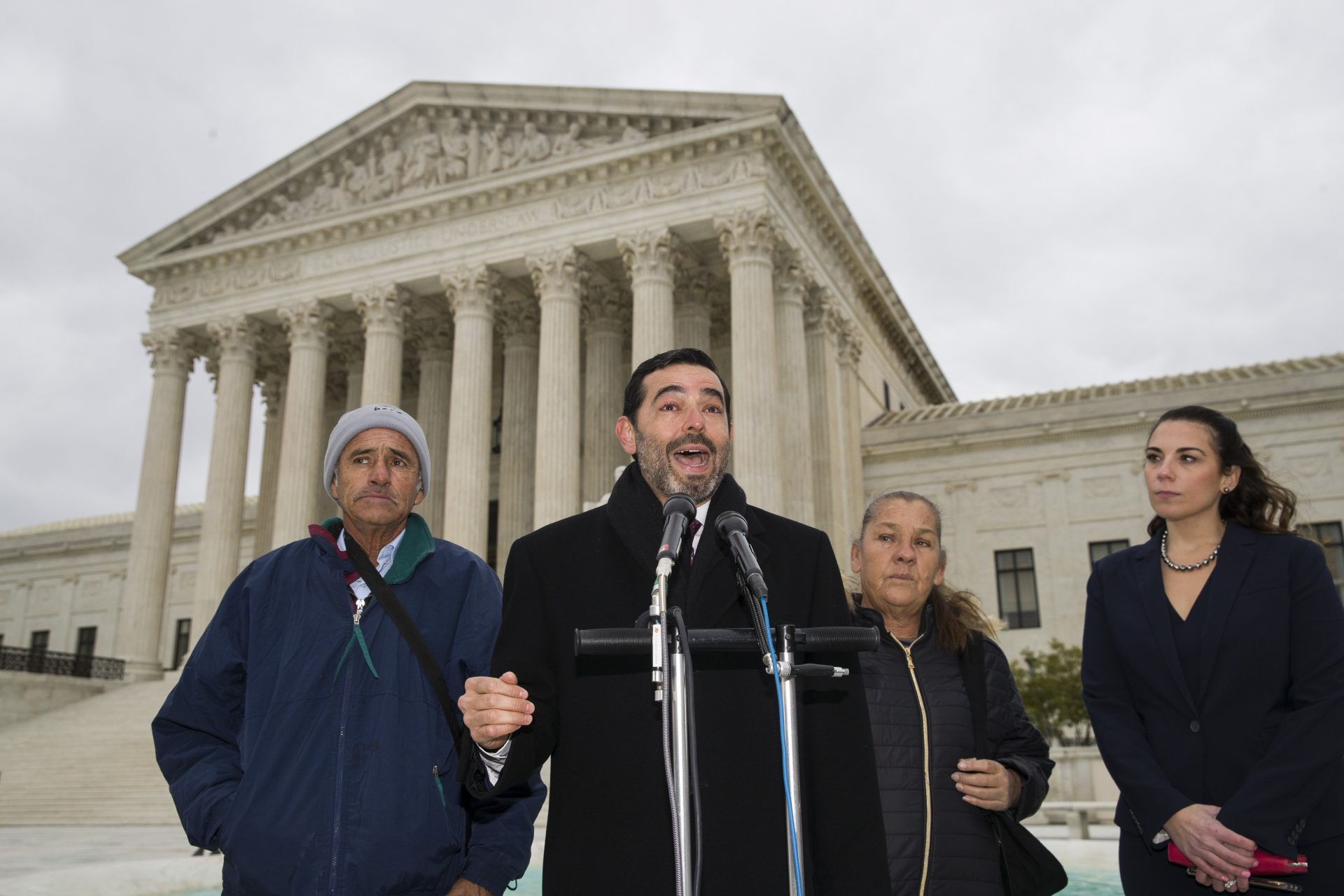 Attorney Cristobal Galindo, second from left, speaks accompanied by Jesus Hernandez, left, and Maria Guereca, and attorney Marion Reilly after oral arguments in front of the Supreme Court, Tuesday, Nov. 12, 2019 in Washington. The case involves U.S. border patrol agent Jesus Mesa, Jr., who fired at least two shots across the Mexican border, killing Sergio Adrian Hernandez Guereca, 15, who'd been playing in the concrete culvert between El Paso and Cuidad Juarez.