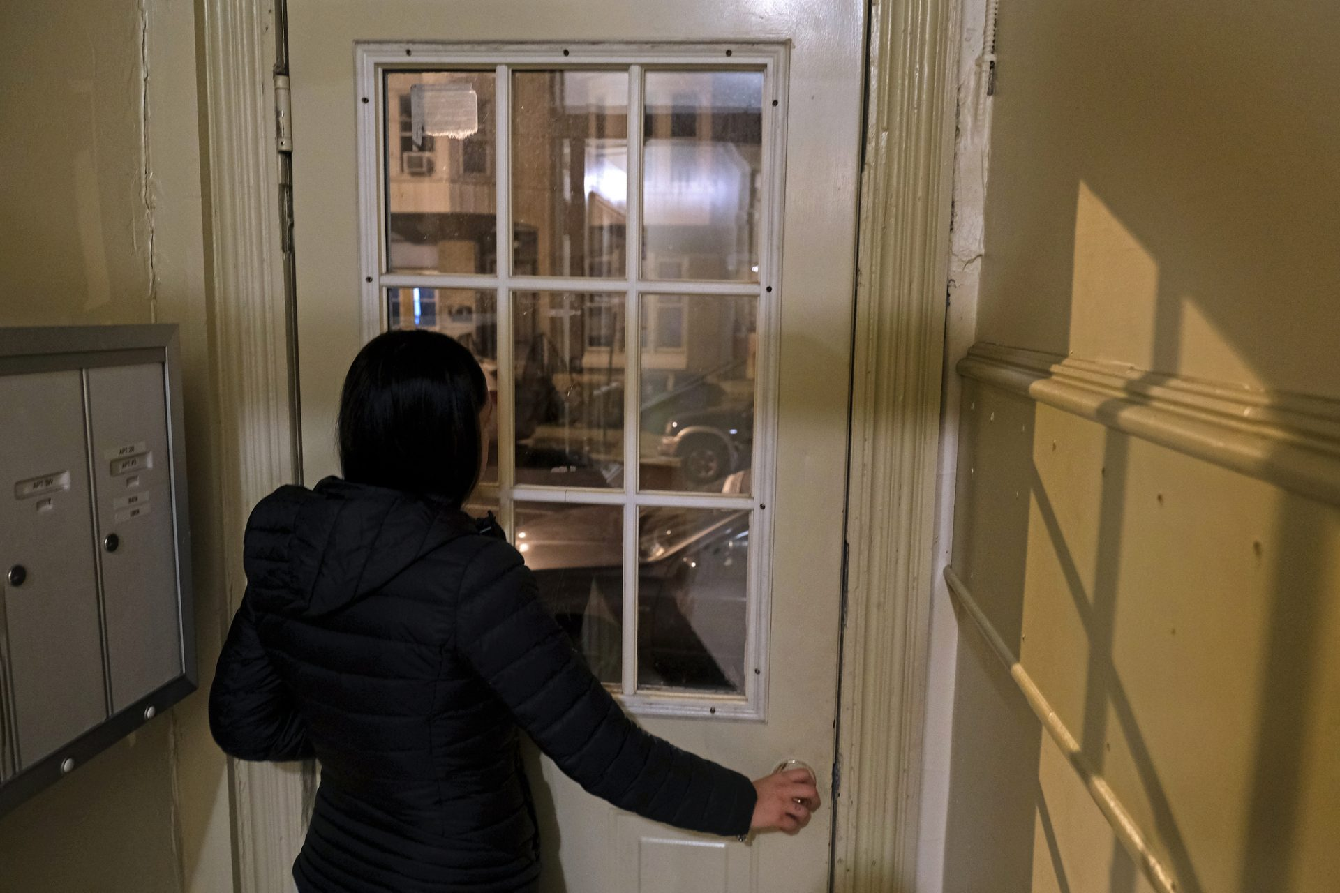 A woman who had been evicted several times stands in the doorway of her current residence Nov. 20, 2019, in Reading, Pennsylvania.