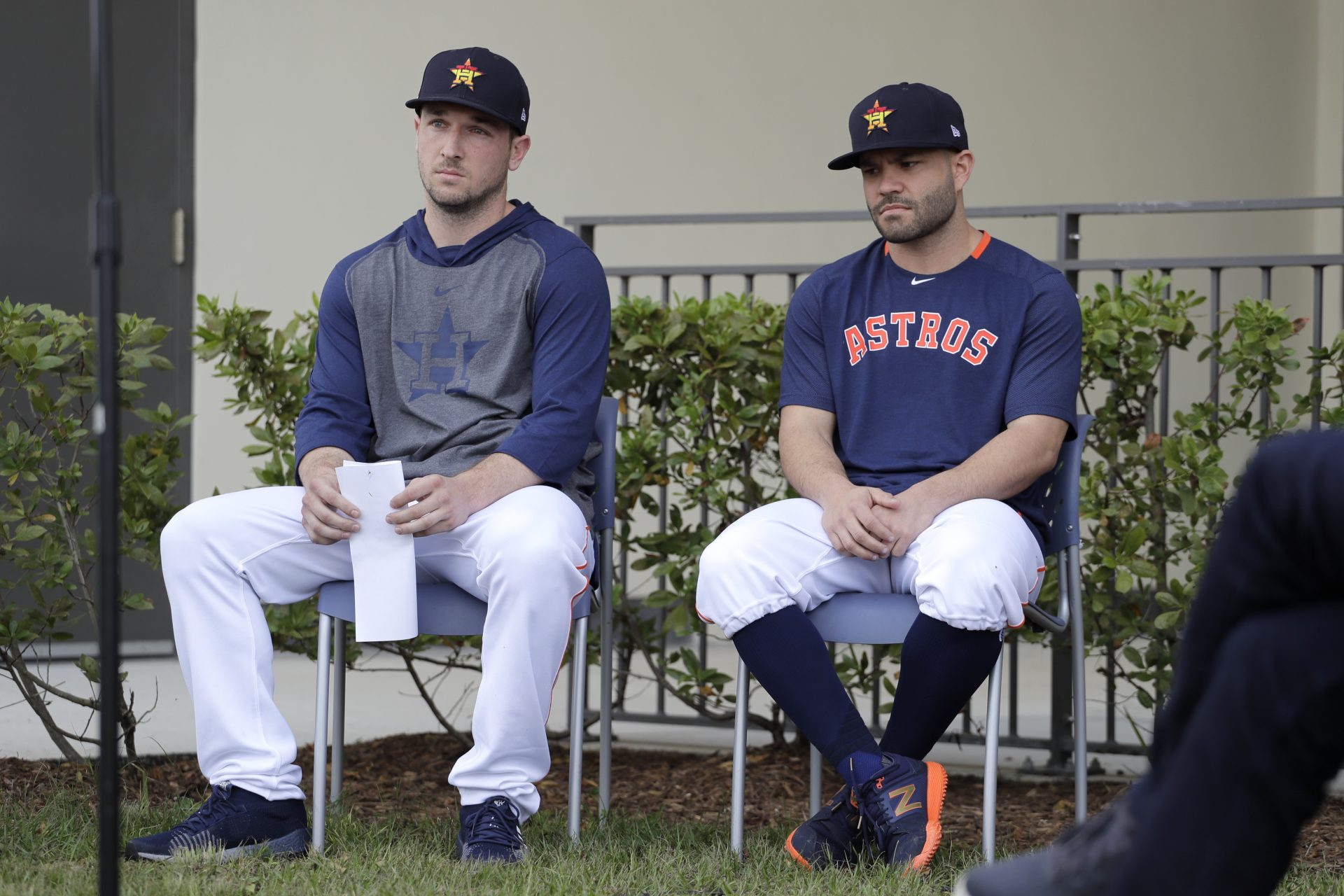Houston Astros infielder Alex Bregman, left, and teammate Jose Altuve sit in chairs as the wait to deliver statements during a news conference before the start of the first official spring training baseball practice for the team Thursday, Feb. 13, 2020, in West Palm Beach, Fla.