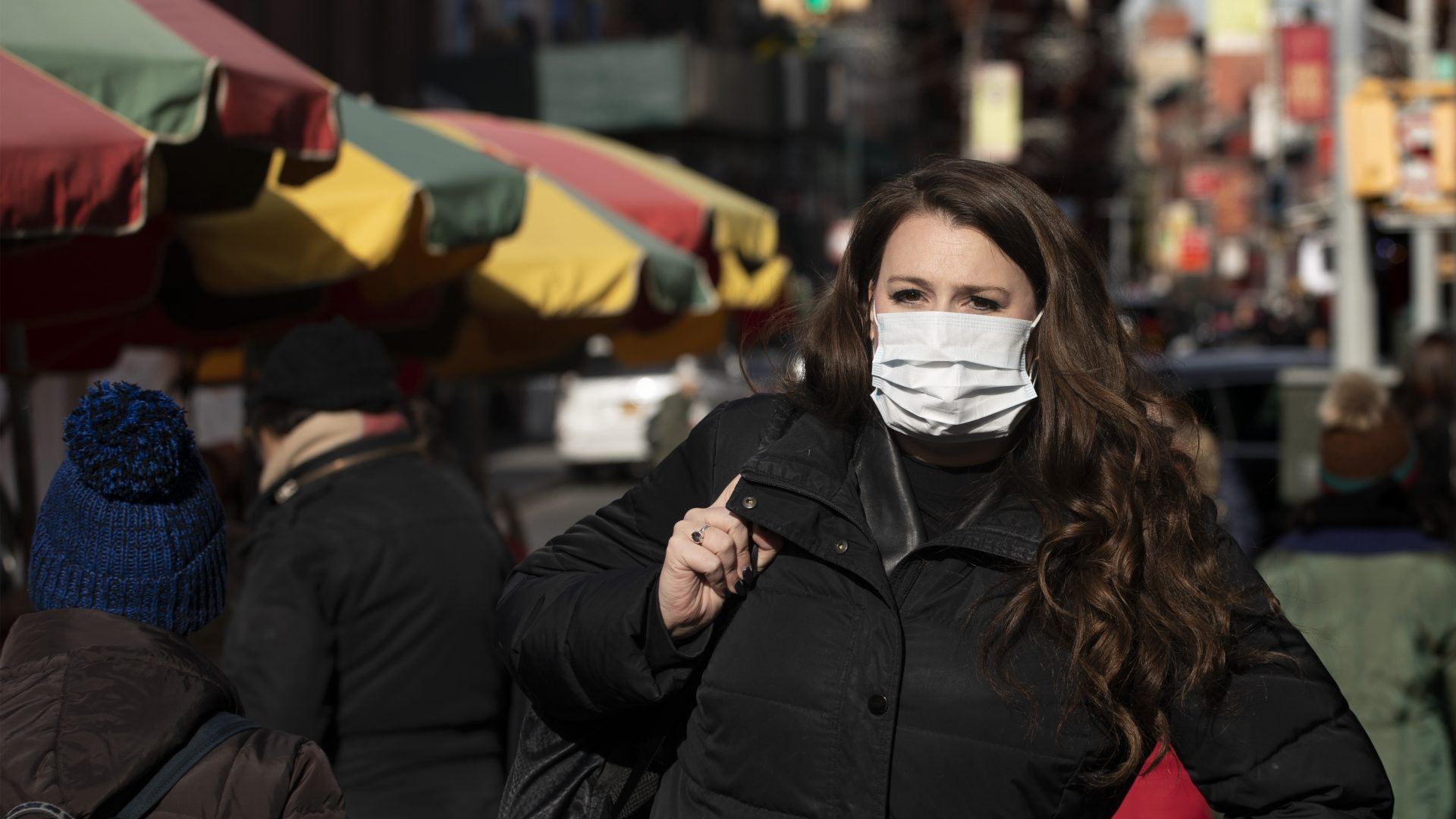 A woman, who declined to give her name, wears a mask in New York out of concern for the newly emerged coronavirus.
