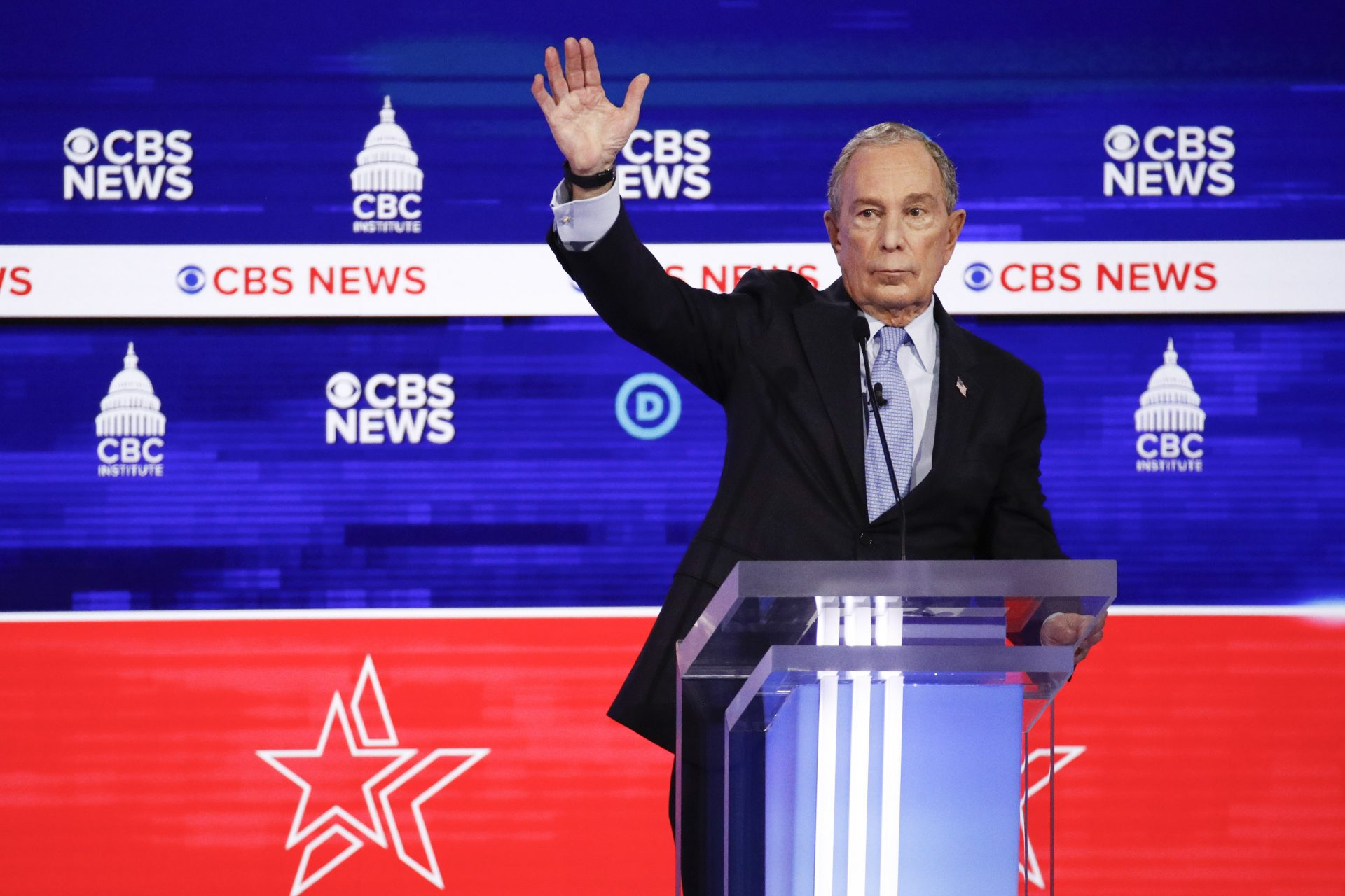 Democratic presidential candidates, former New York City Mayor Mike Bloomberg, raises his hand during the Democratic presidential primary debate at the Gaillard Center, Tuesday, Feb. 25, 2020, in Charleston, S.C., co-hosted by CBS News and the Congressional Black Caucus Institute.