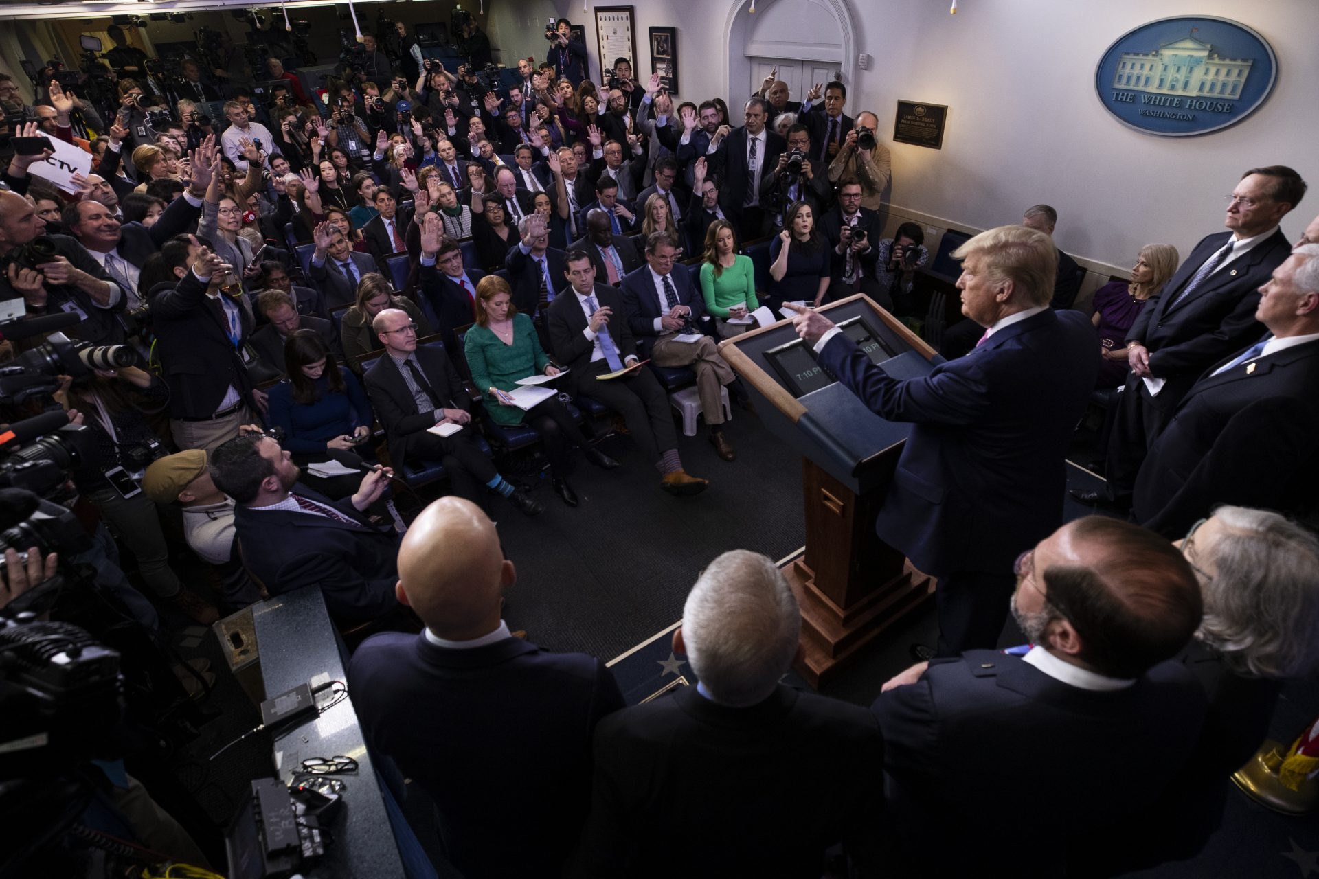 President Donald Trump, with members of the president's coronavirus task force, speaks during a news conference in the Brady Press Briefing Room of the White House, Wednesday, Feb. 26, 2020, in Washington.