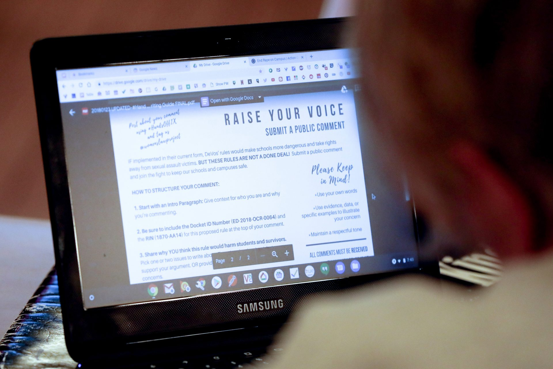 A woman attending the monthly meeting of the southwest Pennsylvania chapter of the National Organization for Women, looks over information as to how people can register their thoughts on the proposed changes to the implementation of Title IX as it pertains to the sexual abuse regulations in education in Monaca, Pa. on Wednesday, Jan. 23, 2019.