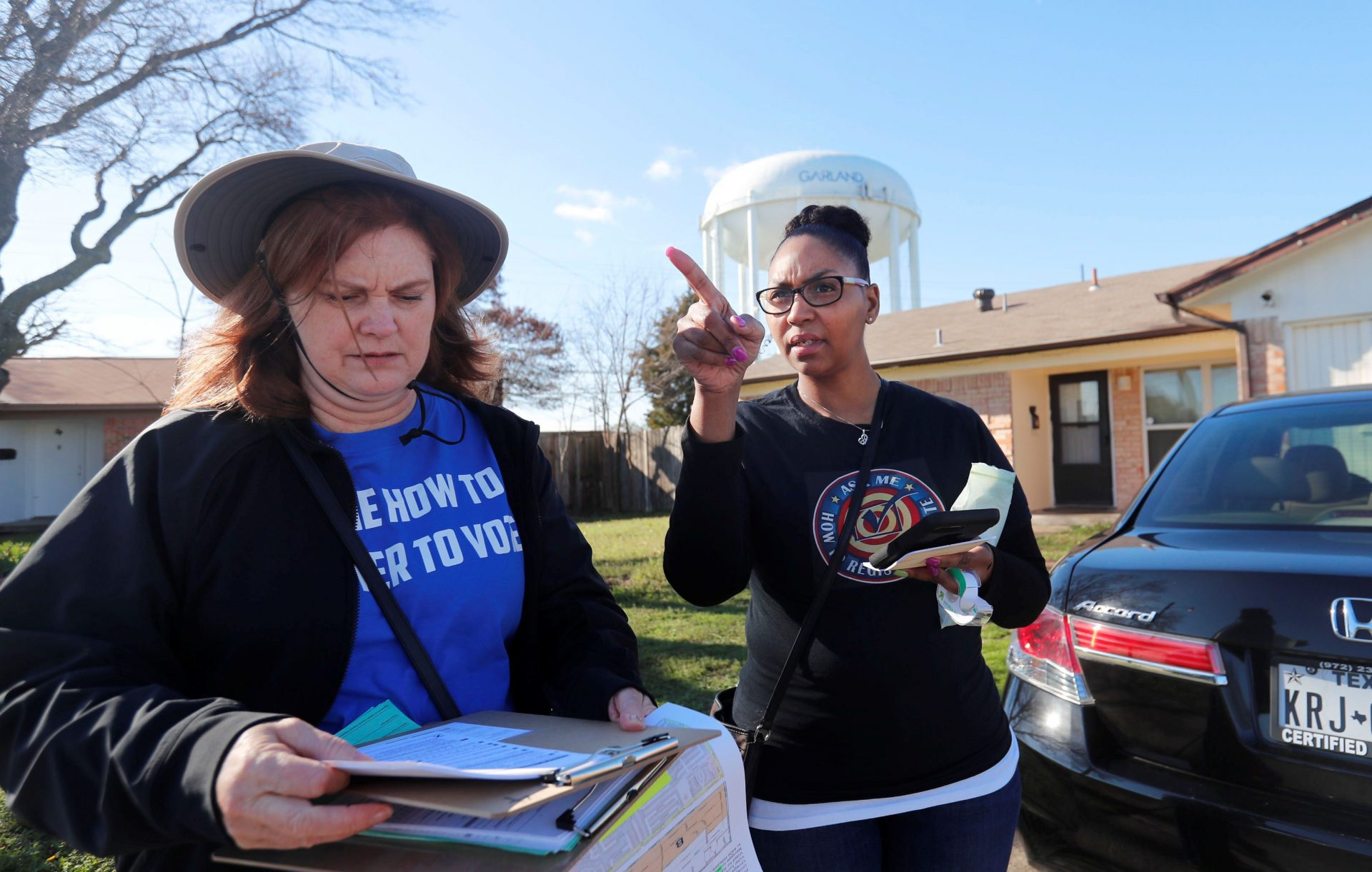 Democratic Party Precinct Chairs Angela Orr Heath, right, and Myla Senn prepare to walk a neighborhood during for a voter registration drive in Garland, Texas, Saturday, Jan. 18, 2020. Democrats are hoping this is the year they can finally make political headway in Texas and have set their sights on trying to win a majority in one house of the state Legislature. Among the hurdles they'll have to overcome are a series of voting restrictions Texas Republicans have implemented in recent years, including the nation's toughest voter ID law, purging of voter rolls and reductions in polling places.