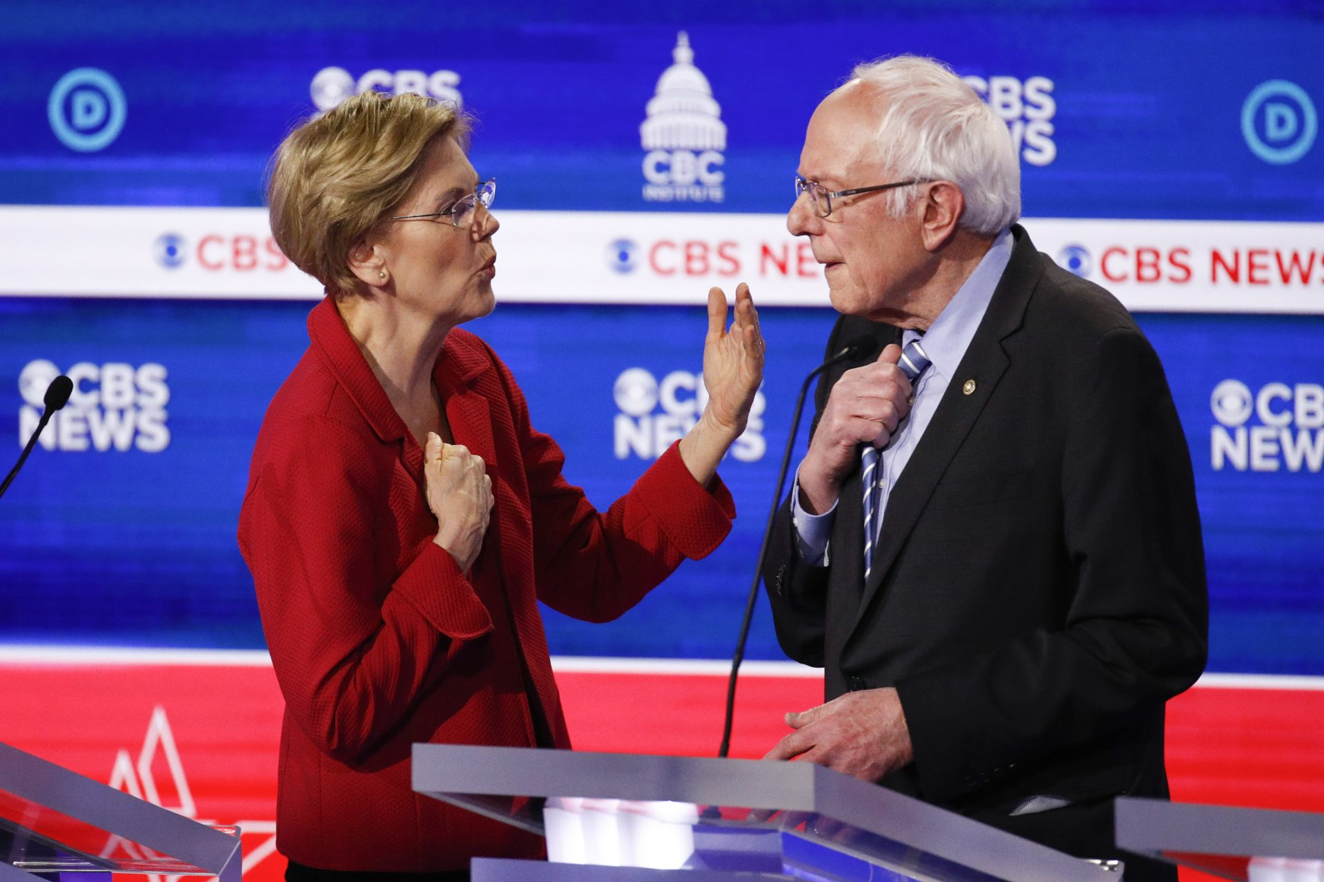 From left, Democratic presidential candidates, Sen. Elizabeth Warren, D-Mass., left, talks with Sen. Bernie Sanders, I-Vt., right, on stage after the Democratic presidential primary debate at the Gaillard Center, Tuesday, Feb. 25, 2020, in Charleston, S.C., co-hosted by CBS News and the Congressional Black Caucus Institute.