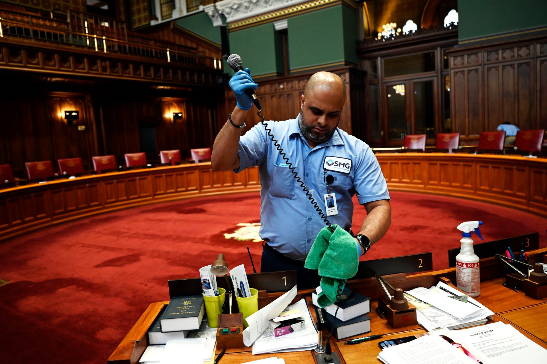 Connecticut's legislature is suspended until at least April 12 to follow the state's social distancing guidelines.Day porter Luis Almenas disinfected all the microphones during a deep clean in the Senate chambers on March 12.