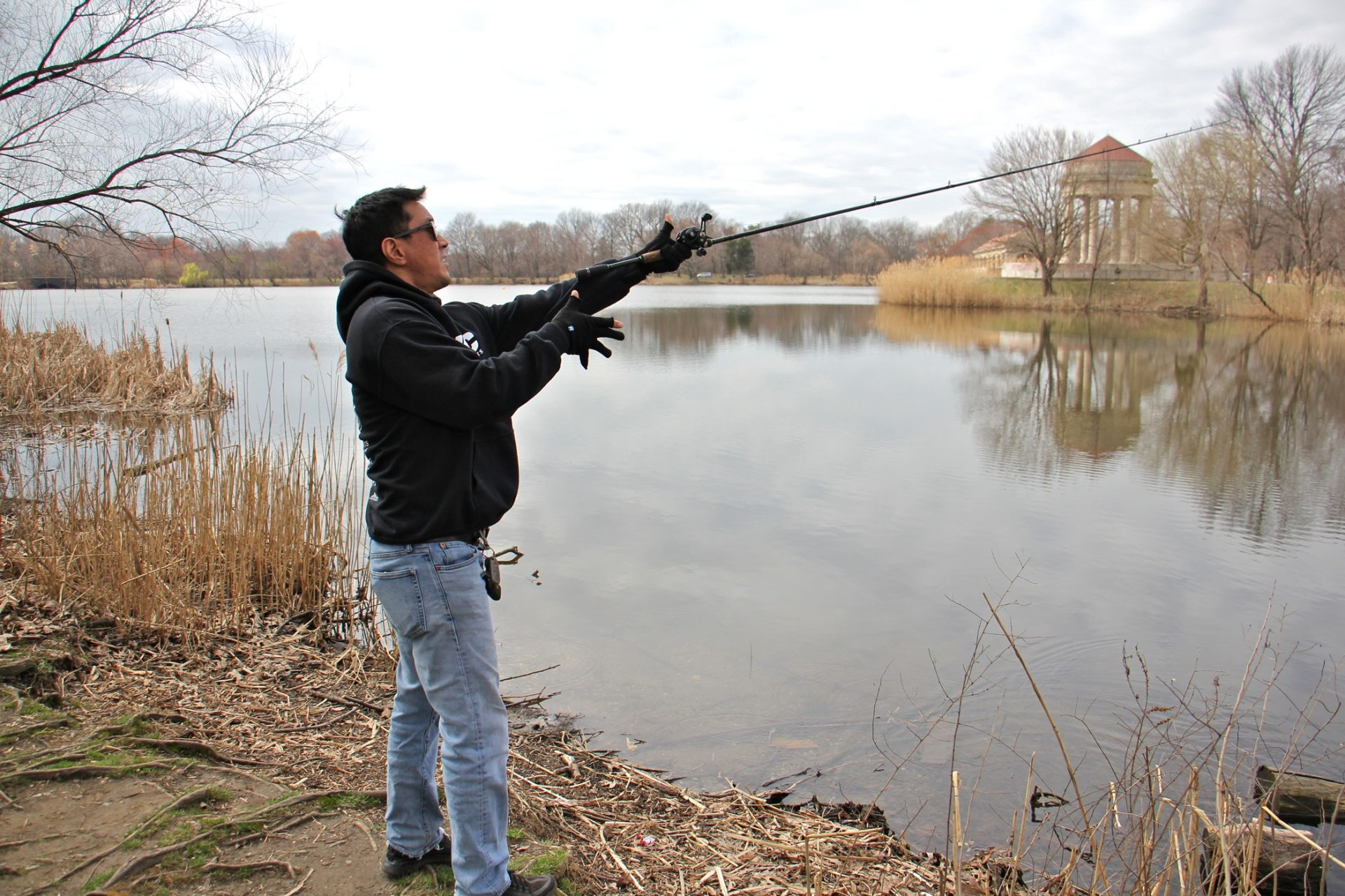 Tony Yoon fishes at Meadow Lake in FDR Park.