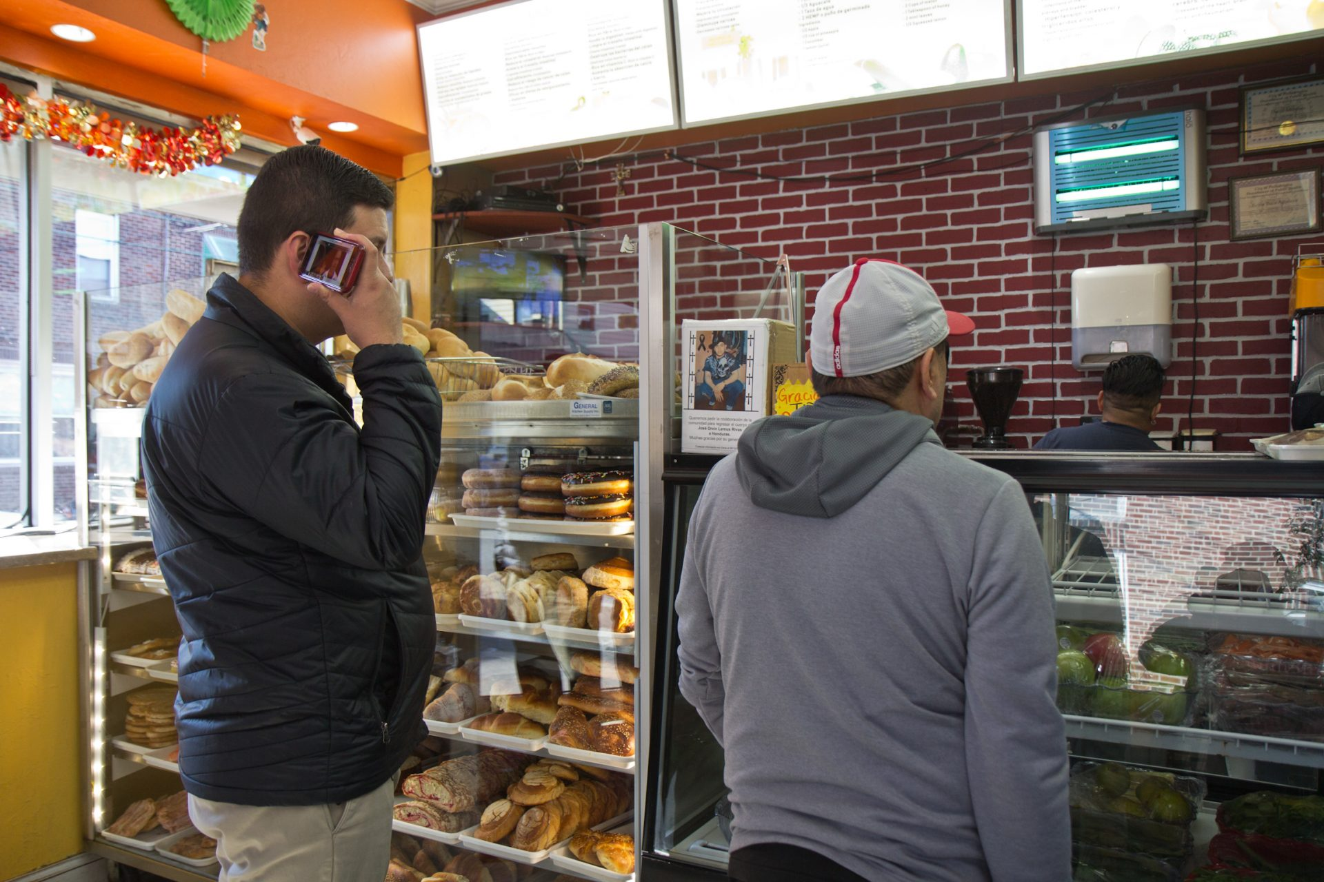 Customers stand in line in Rosa's bakery in South Philadelphia.