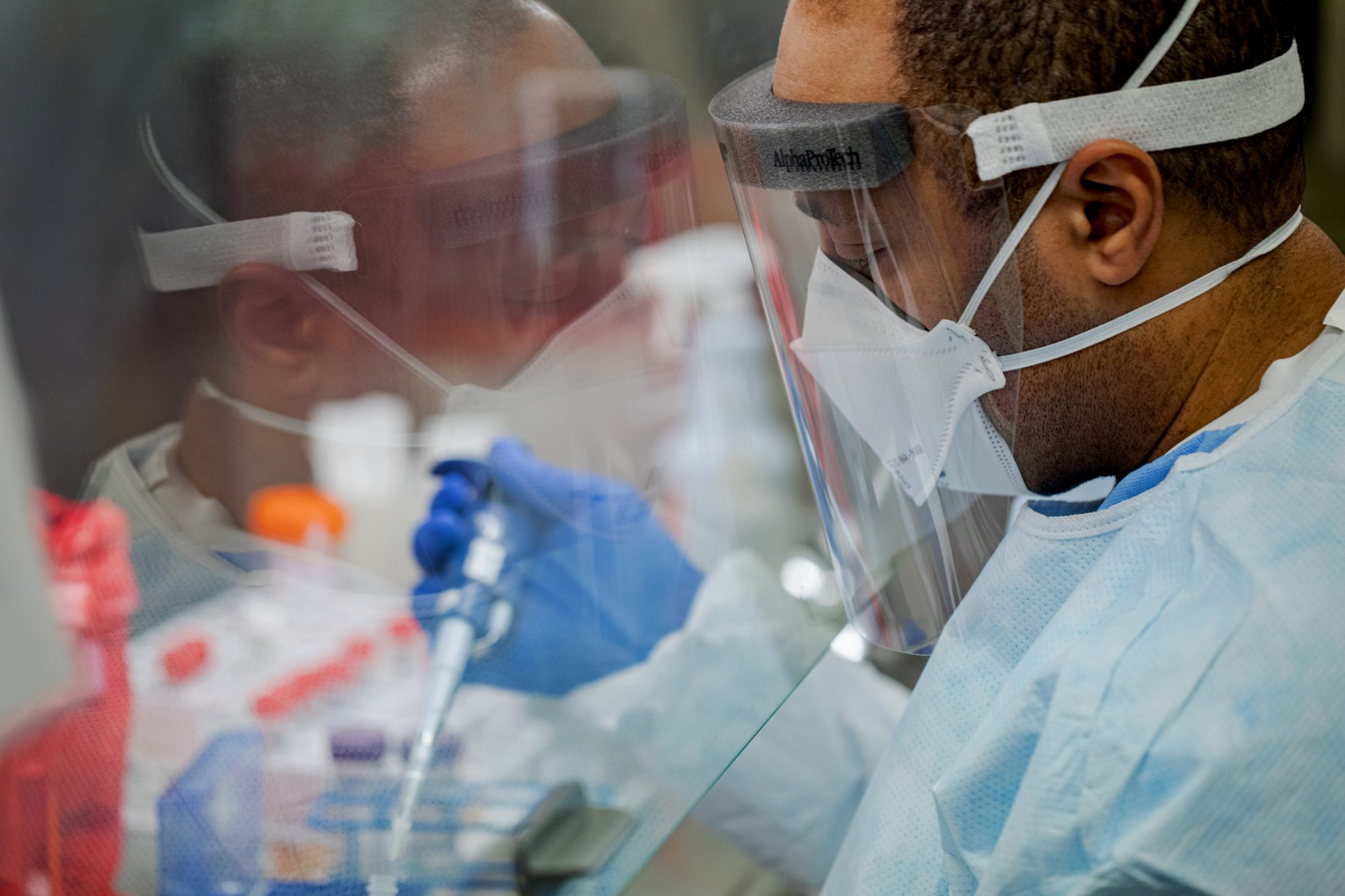 Pennsylvania Commonwealth microbiologist Kerry Pollard performs a manual extraction of the coronavirus inside the extraction lab at the Pennsylvania Department of Health Bureau of Laboratories on Friday, March 6, 2020.
