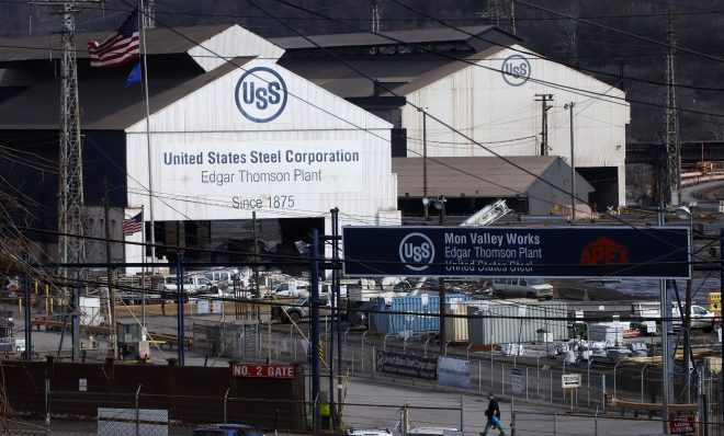 """A worker leaves the U.S Steel Edgar Thomson Works in Braddock, Pa., Thursday, March 26, 2020. The plant was exempted from Pennsylvania Gov. Tom Wolf's order on Monday for """"non-life sustaining"""" businesses to close. (AP Photo/Gene J. Puskar)"""
