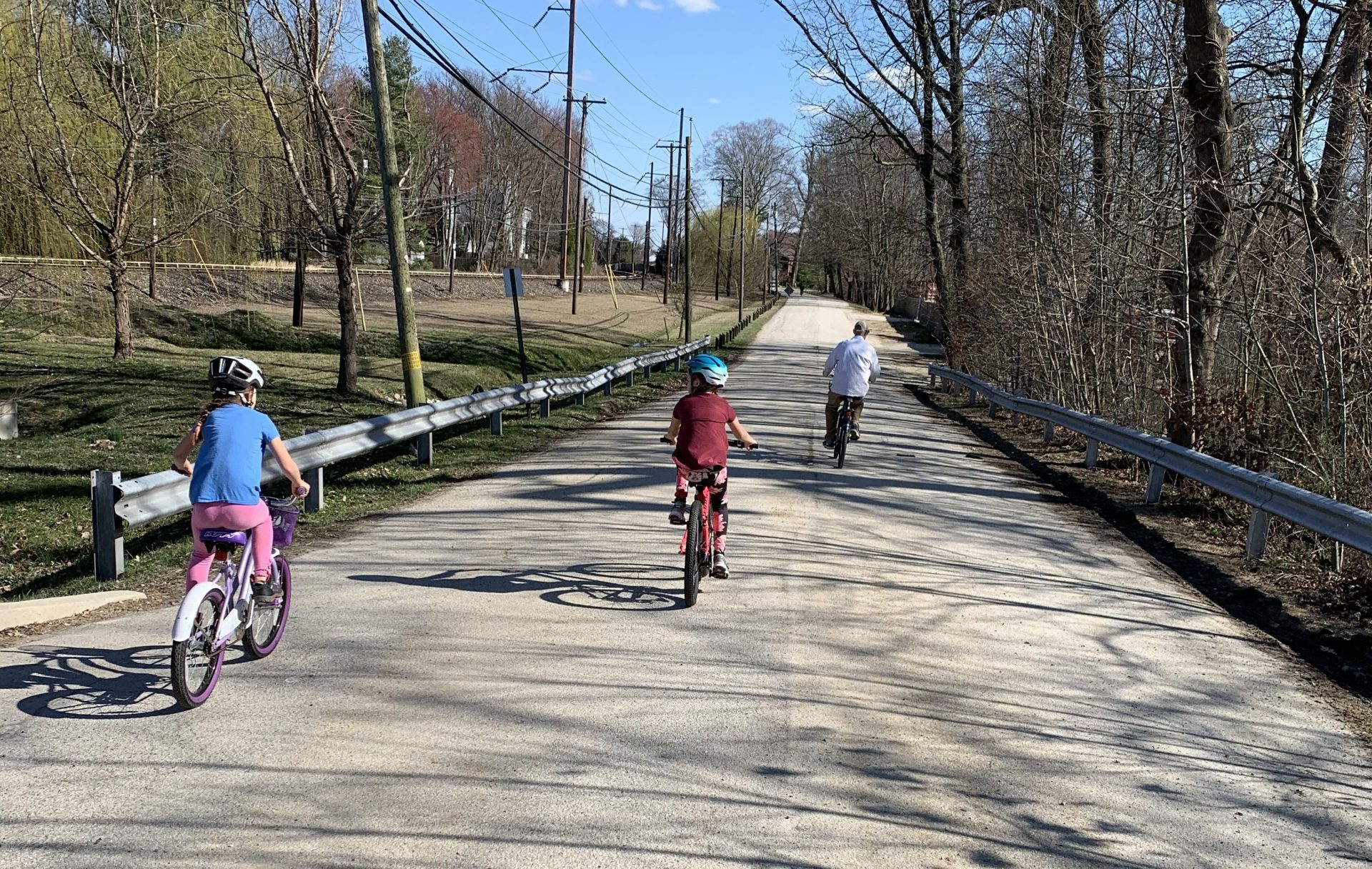 Friends' Central Lower School teacher Tiffany Borsch accompanies her children on a bike ride during the first day of state-wide school closures.