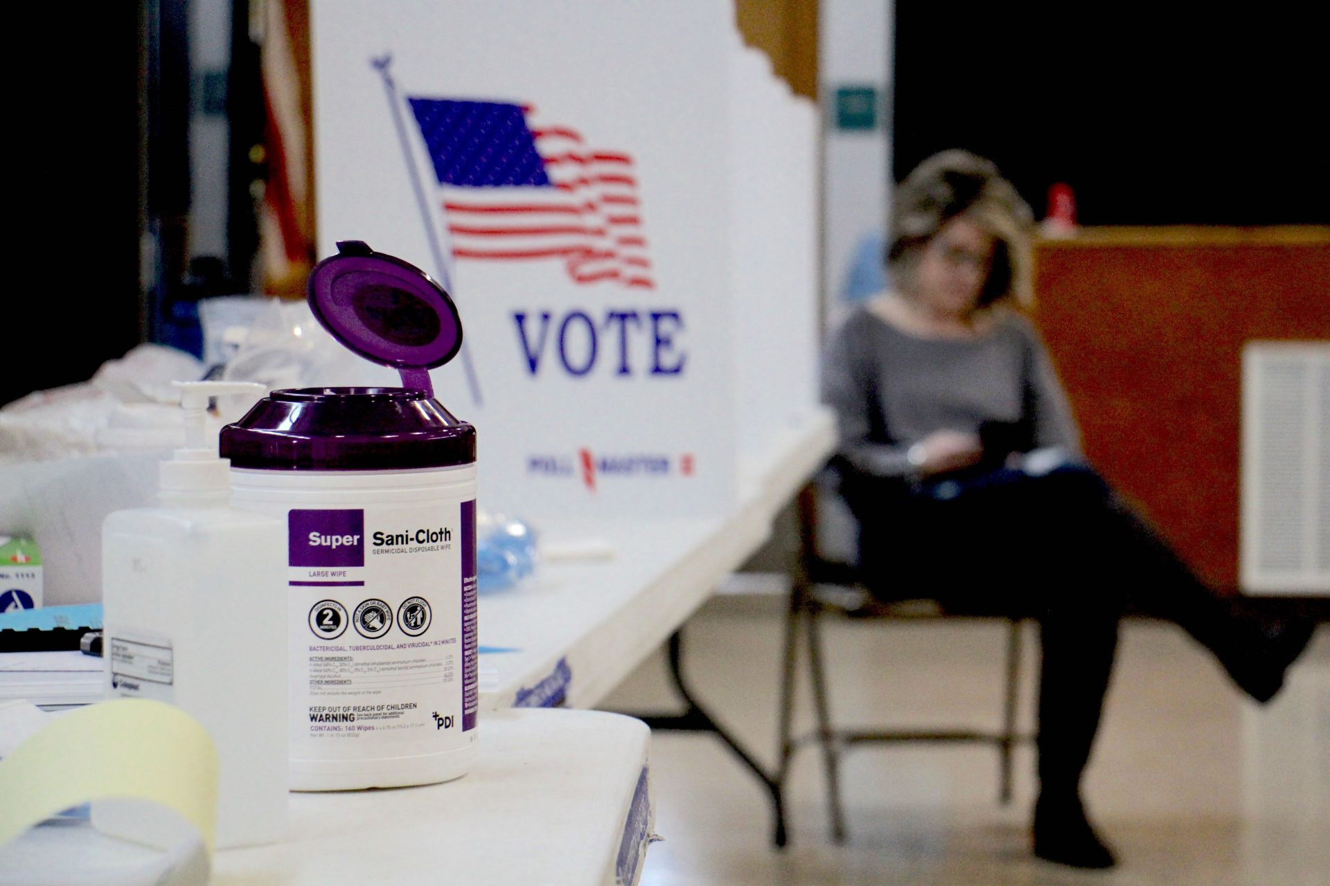 Poll worker Dina Sebold waits for voters at Cecelia Snyder Middle School in Bensalem during a special election for a vacant seat in the Pennsylvania House of Representatives. Hand sanitizer and wipes were made available to voters, many of whom brought their own pens.