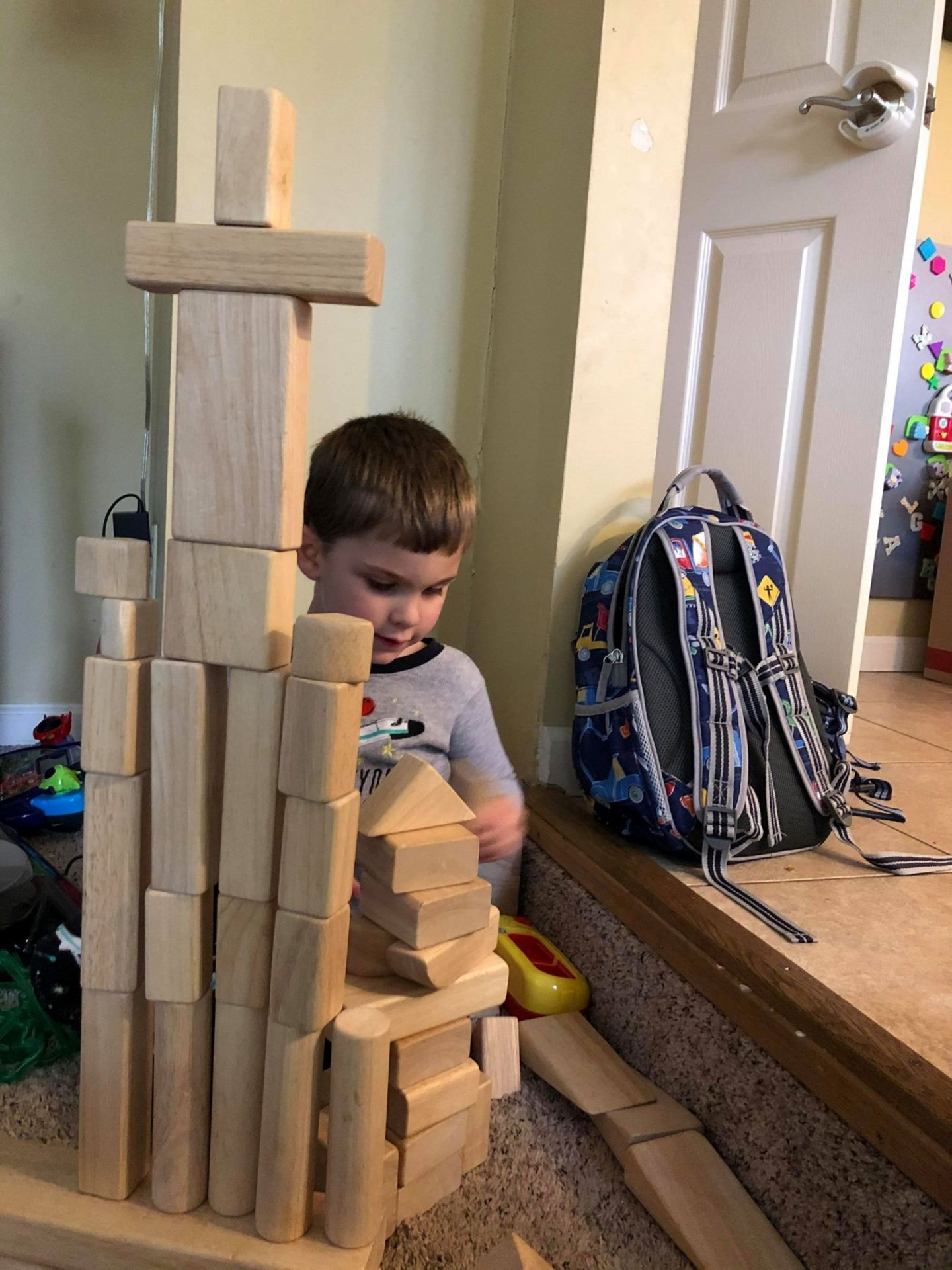 Tara Ryan-Schill's 3-year-old son Jacob plays with blocks at home.