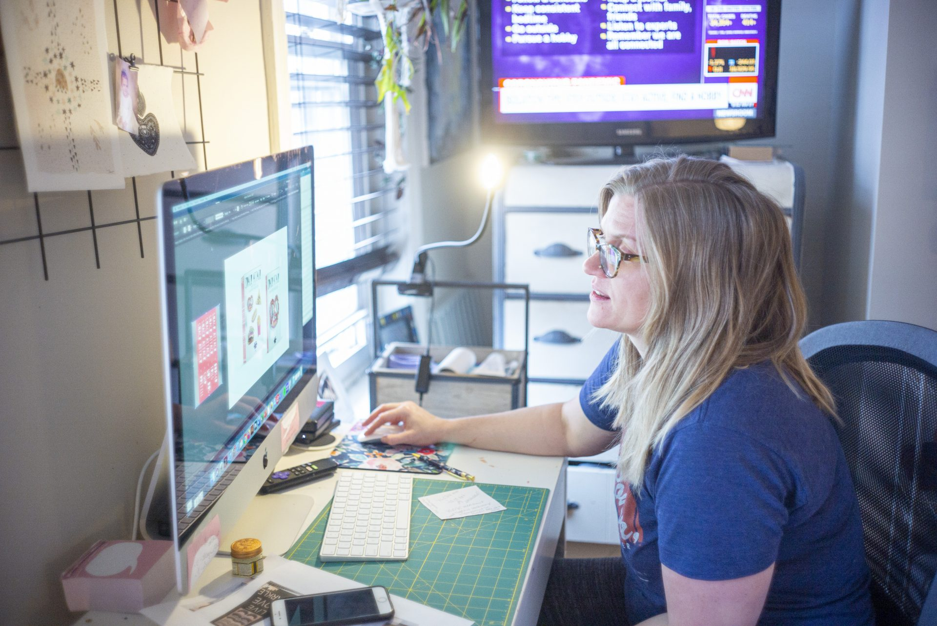 Art director Heather Marley works remotely from home while she is isolated at her Roxborough home.