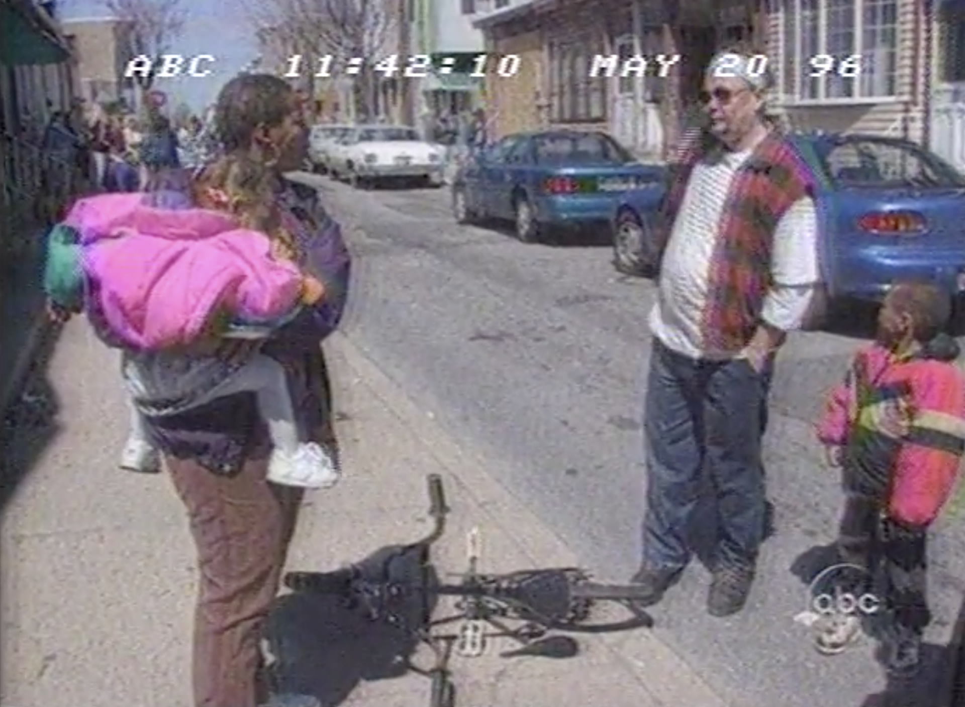 Bridesburg residents talking in the street amid a media circus during Nightline's 1996 feature.
