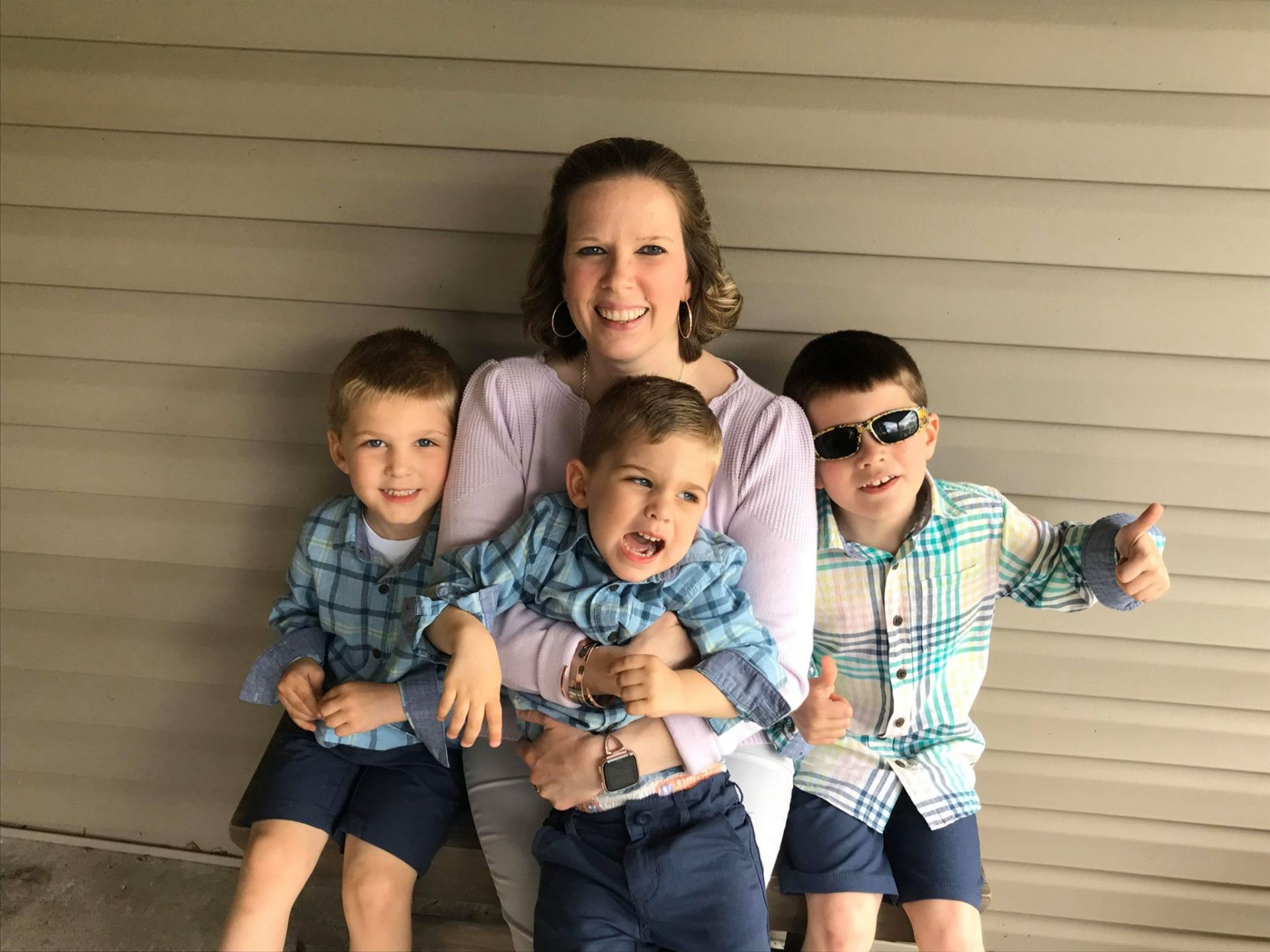 Tara Ryan-Schill with her sons (from left to right), Luke, 5, Jacob, 3, and Andrew, 8.
