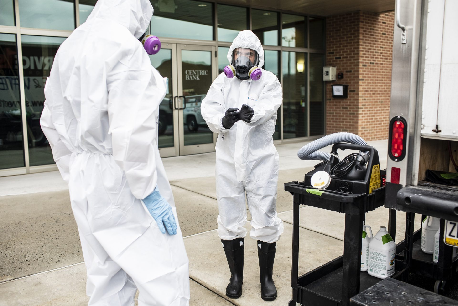 Service 1st Restoration worker Adam Copenhaver prepares to spray disinfectant throughout the Centric Bank corporate headquarters to stop the spread of the coronavirus.