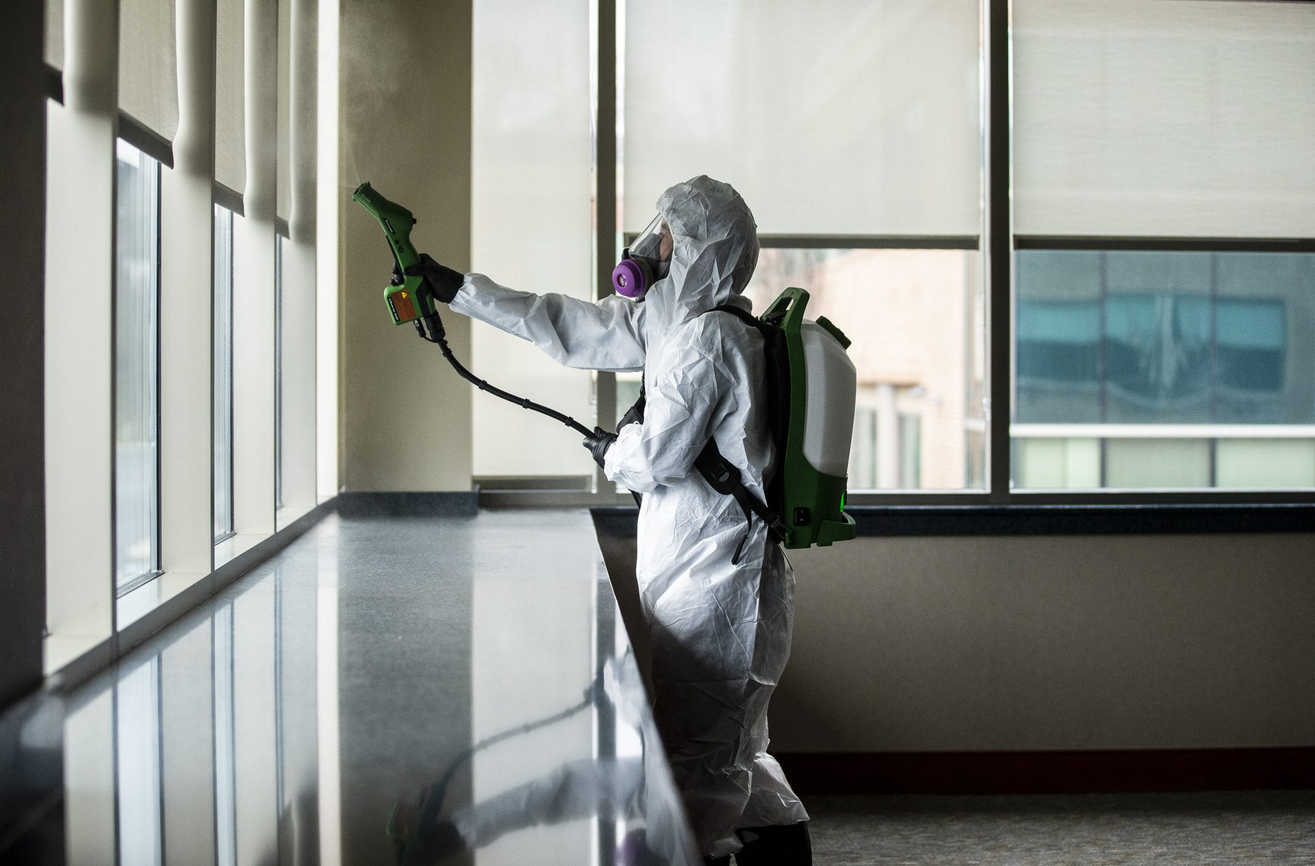 Service 1st Restoration worker Adam Copenhaver sprays disinfectant throughout the Centric Bank corporate headquarters to stop the spread of the coronavirus.
