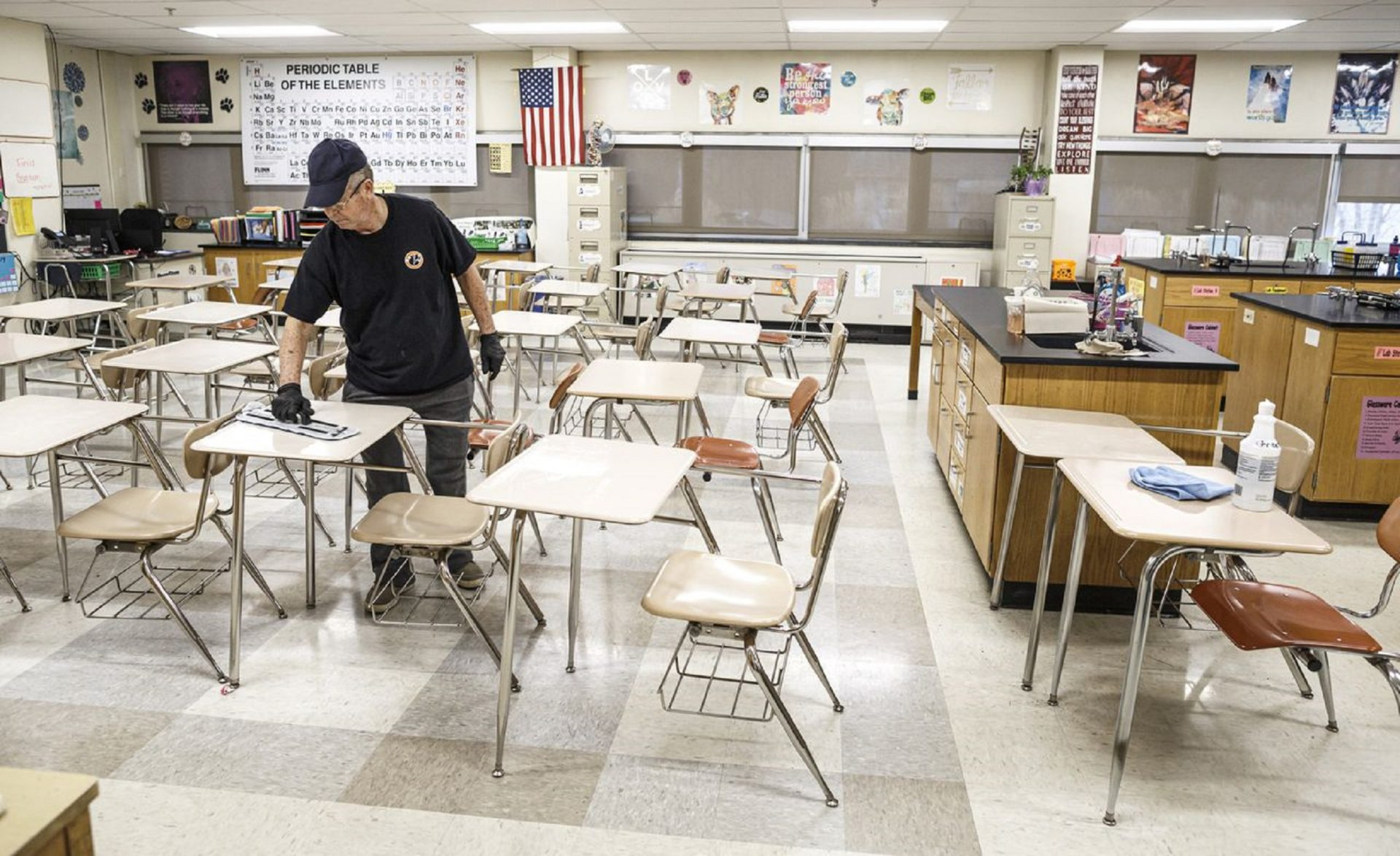 Custodian Luis Perez uses a cleaning solution applied to a cloth to wipe down all high-touch areas in a chemistry classroom. Custodial staff at East Pennsboro High School sanitize surfaces each day as a precautionary measure for the coronavirus, known as COVID-19, March 11, 2020.