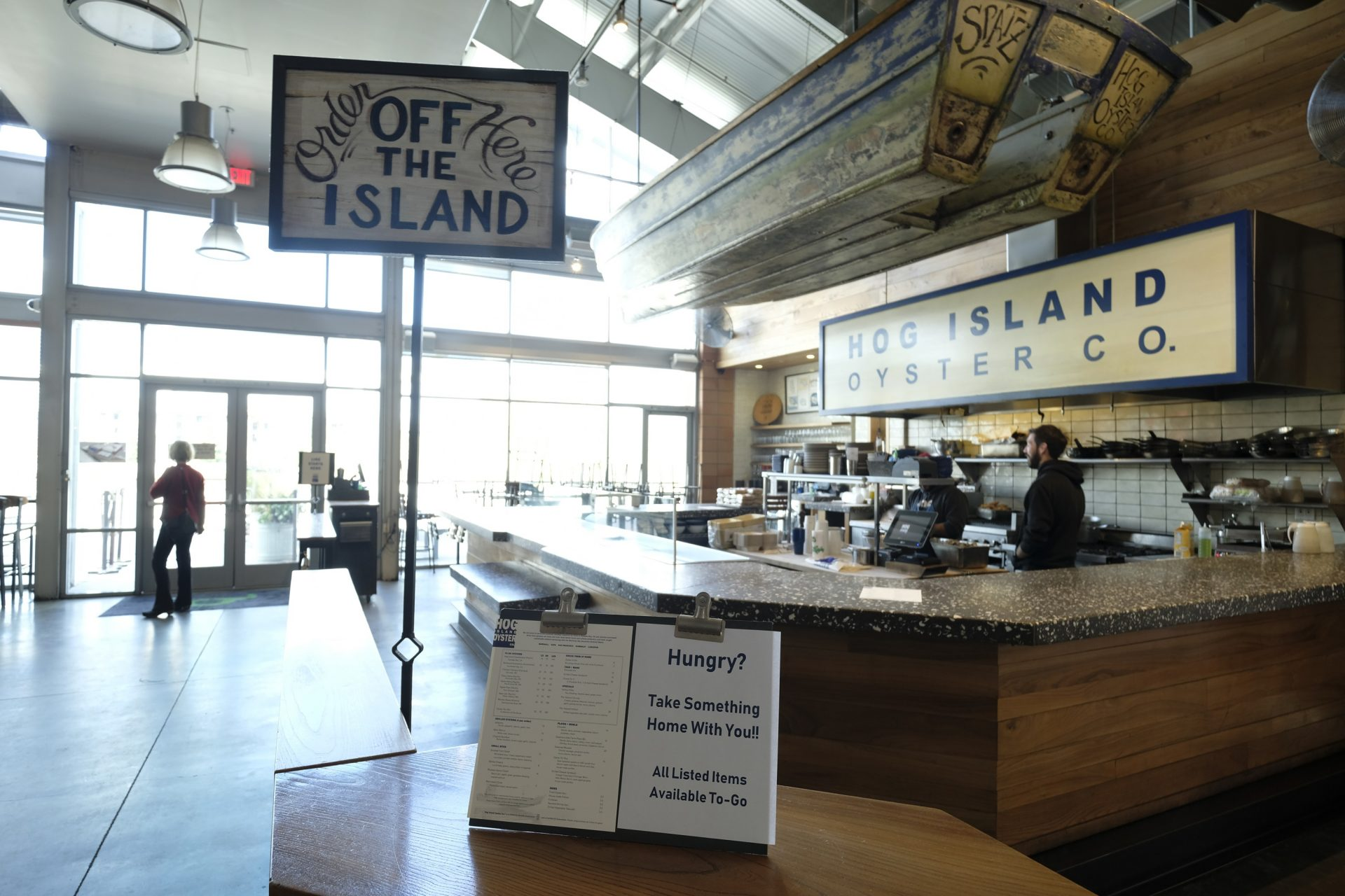 The popular Hog Island Co. oyster bar sits empty at the Oxbow Public Market, but remains open for takeout orders only Thursday, March 19, 2020, in Napa, Calif. As worries about the spread of the coronavirus confine millions of Californians to their homes, concern is growing about those who have no homes in which to shelter