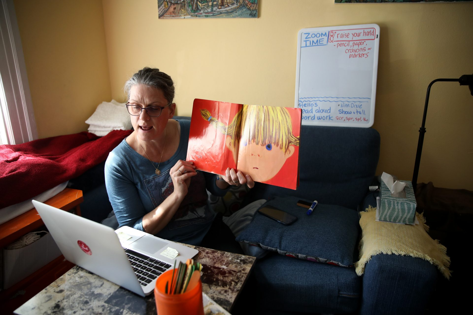 Leanne Francis, first grade teacher at Harvey Milk Civil Rights Academy, conducts an online class from her living room on March 20, 2020 in San Francisco, Calif.With schools closed across theU.S., teachers are holding some classes online.
